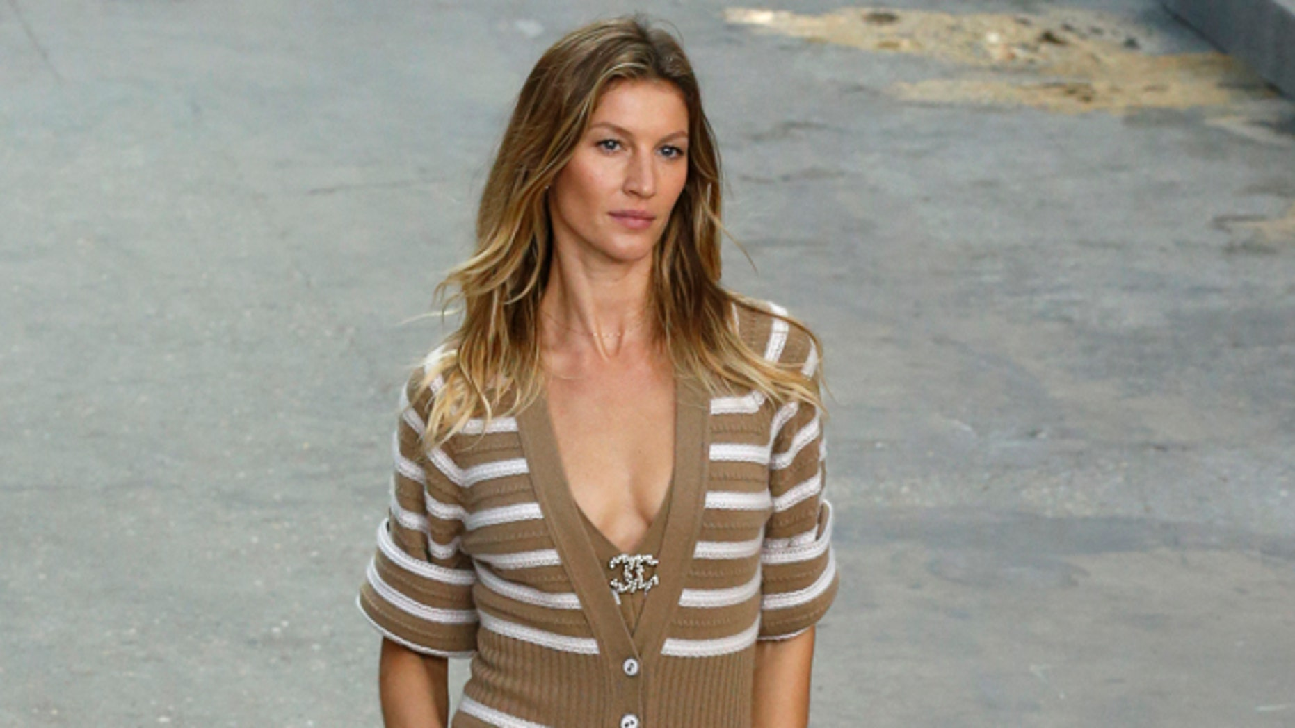 Model Giselle Bundchen wears a creation for Chanel's Spring/Summer 2015 ready-to-wear fashion collection presented in Paris, France, Tuesday, Sept. 30, 2014. (AP Photo/Francois Mori)