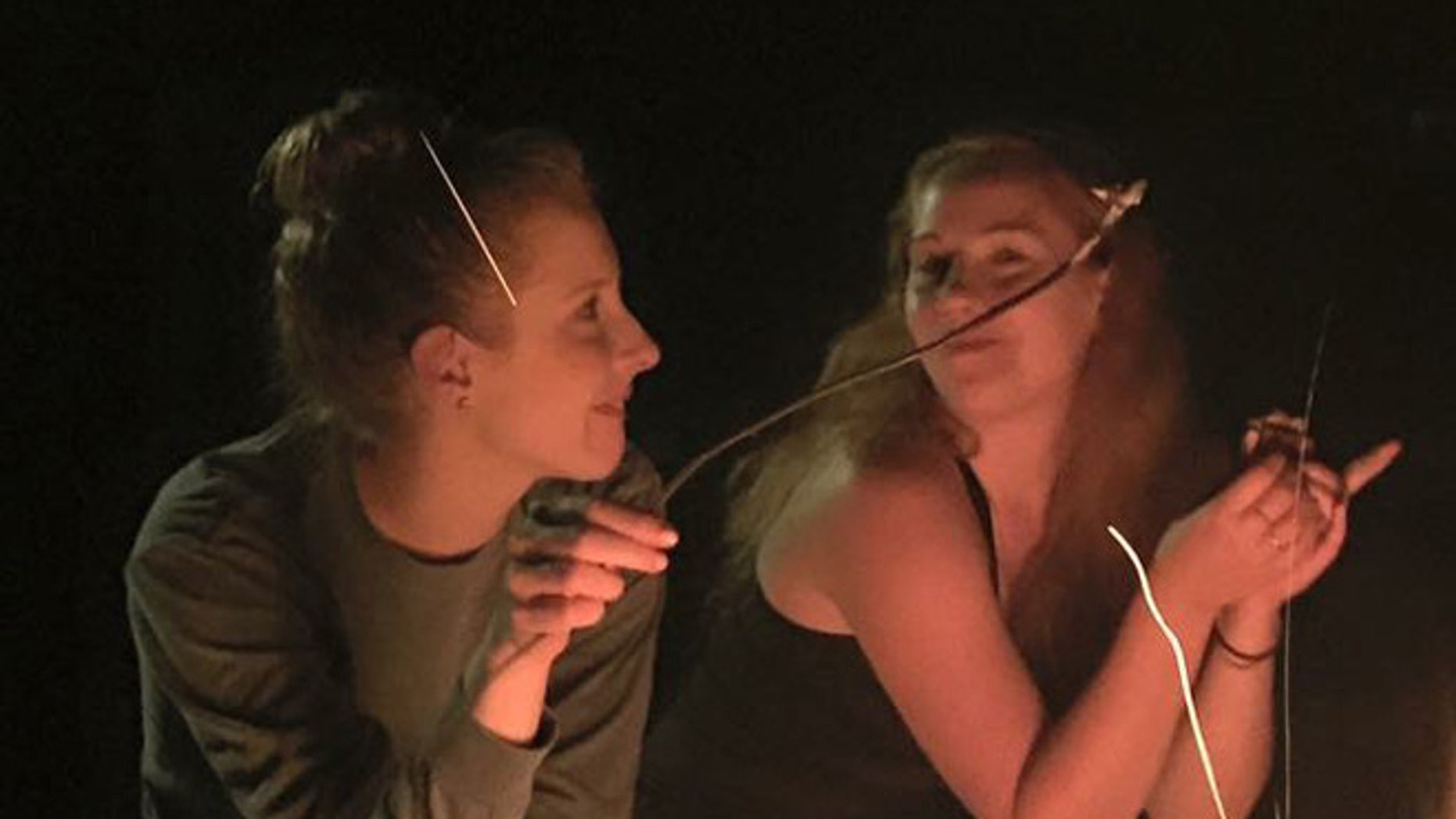 Friends Alison Parker (left) and Katy Summerlin on vacation near Ashville, N.C., in late-August 2015, days before Parker was murdered.