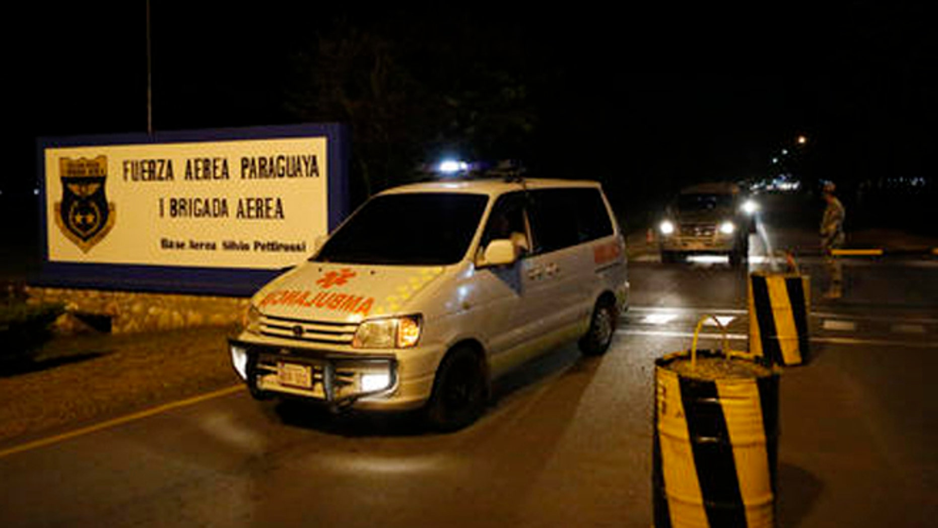 Ambulances transport the coffin of one of Paraguay's army soldiers killed in an attack on Saturday, Aug. 27, 2016, in Arroyito at asuncion airport, Paraguay. Suspected members of a little-known Paraguayan guerrilla group killed multiple soldiers in the attack in Arroyito. (AP Photo/Jorge Saenz)