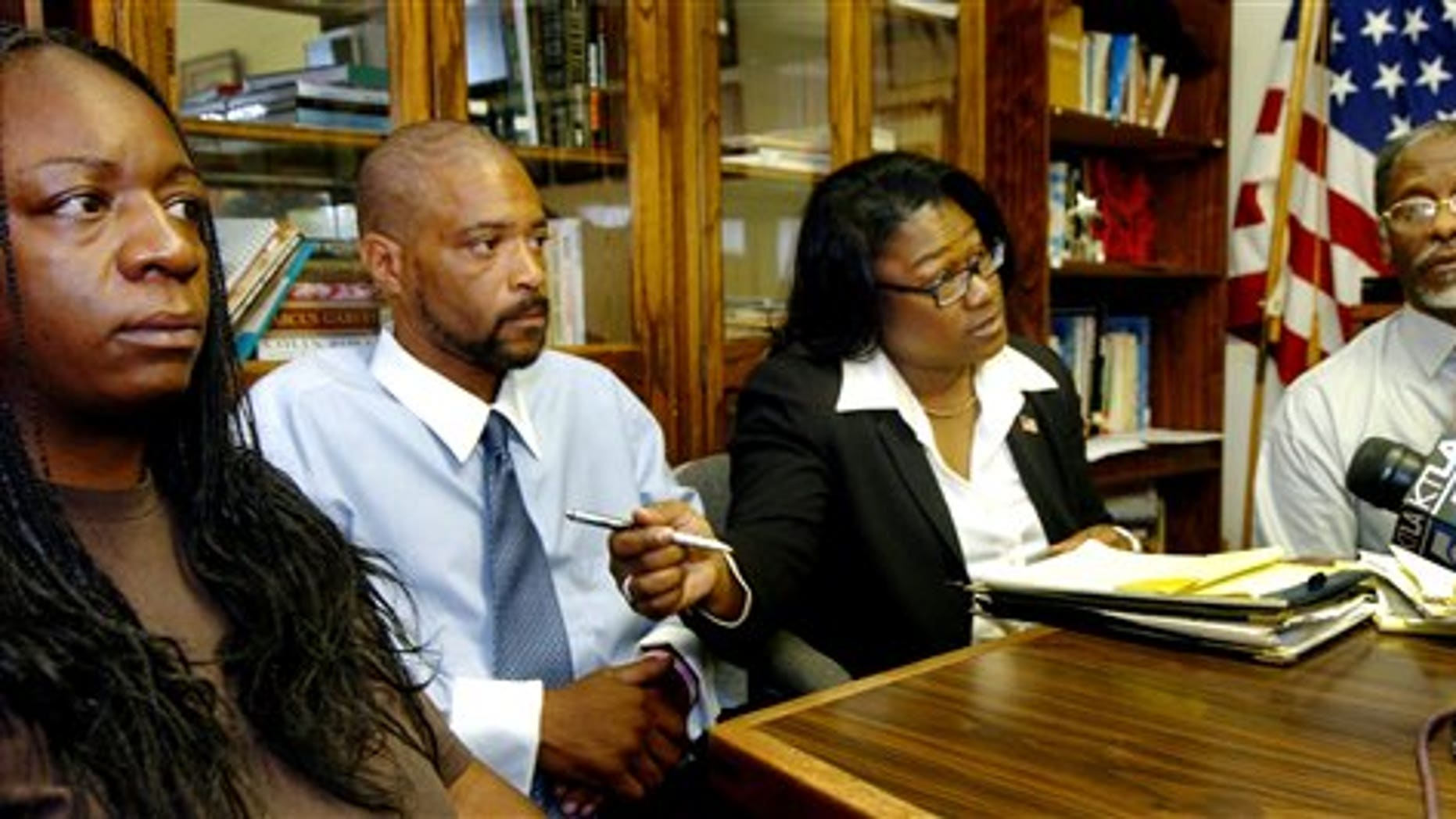 March 28: From left, Anya Slaughter, the mother of Kendrec McDade; Kenneth McDade, his father; Caree Harper, the family's attorney, and Joe Brown, president of the NAACP's Pasadena branch, answer questions about Kendrec McDade's shooting at the Pasadena Branch of NAACP in Pasadena, Calif.