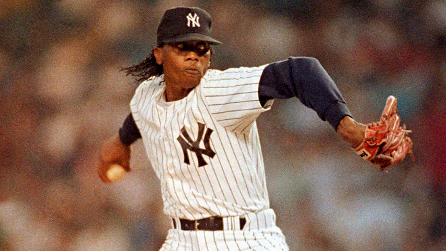 FILE 1991: New York Yankees' Pascual Perez throws during the second inning of a baseball game against the California Angels at Yankee Stadium in New York.