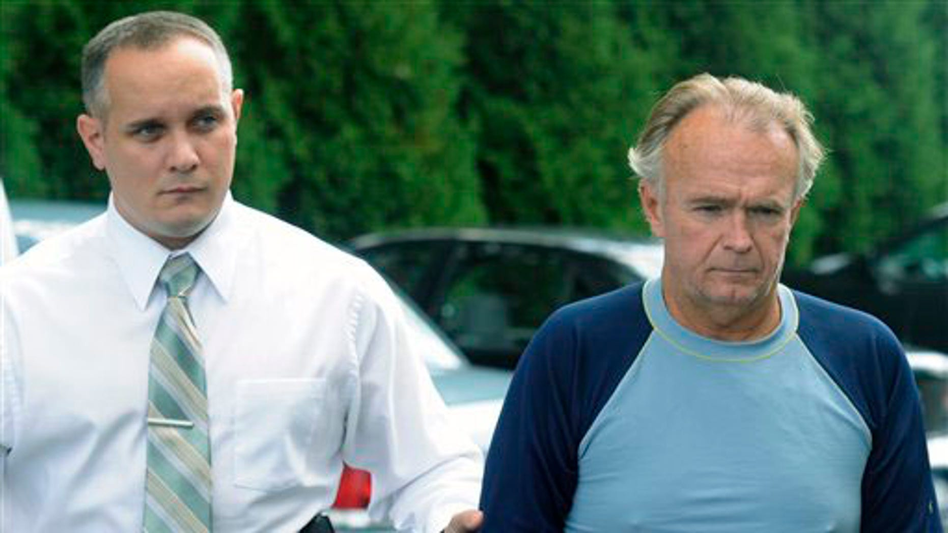 The Rev. Arthur Burton Schirmer, 62, right, is led into district court by Pennsylvania State Trooper Bill Skotleski in Tannersville, Pa., on Monday, Sept. 13, 2010. Schirmer is accused of killing his wife and staging a car accident in July 2008 to cover up the murder.