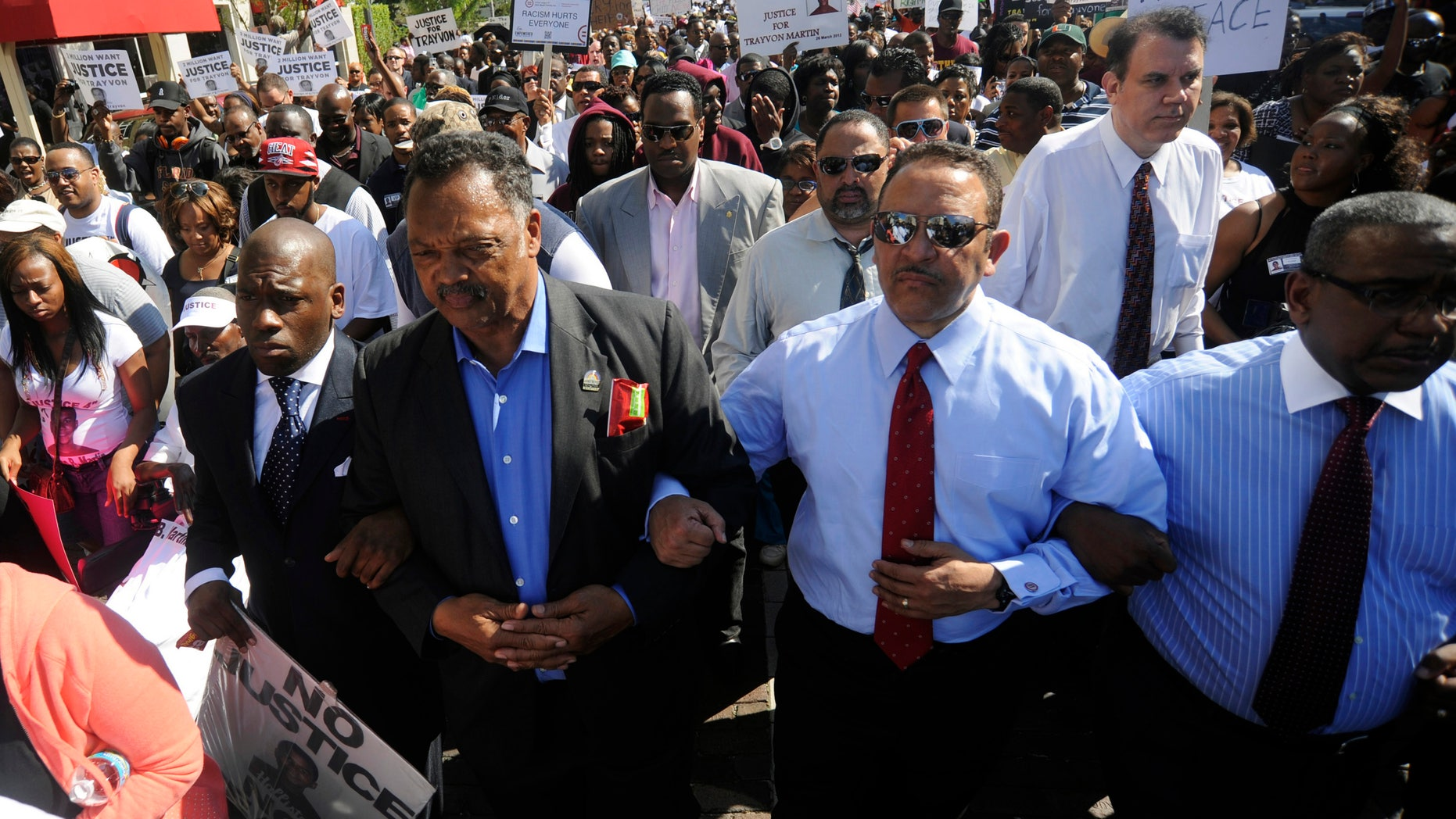 FILE: March 26, 2012: The Rev. Jesse Jackson (C) and Pastor Jamal Bryant, seen in a Sanford, Fla., march, are among the country's most influential black church leaders. Some are telling their congregations not to vote in November.