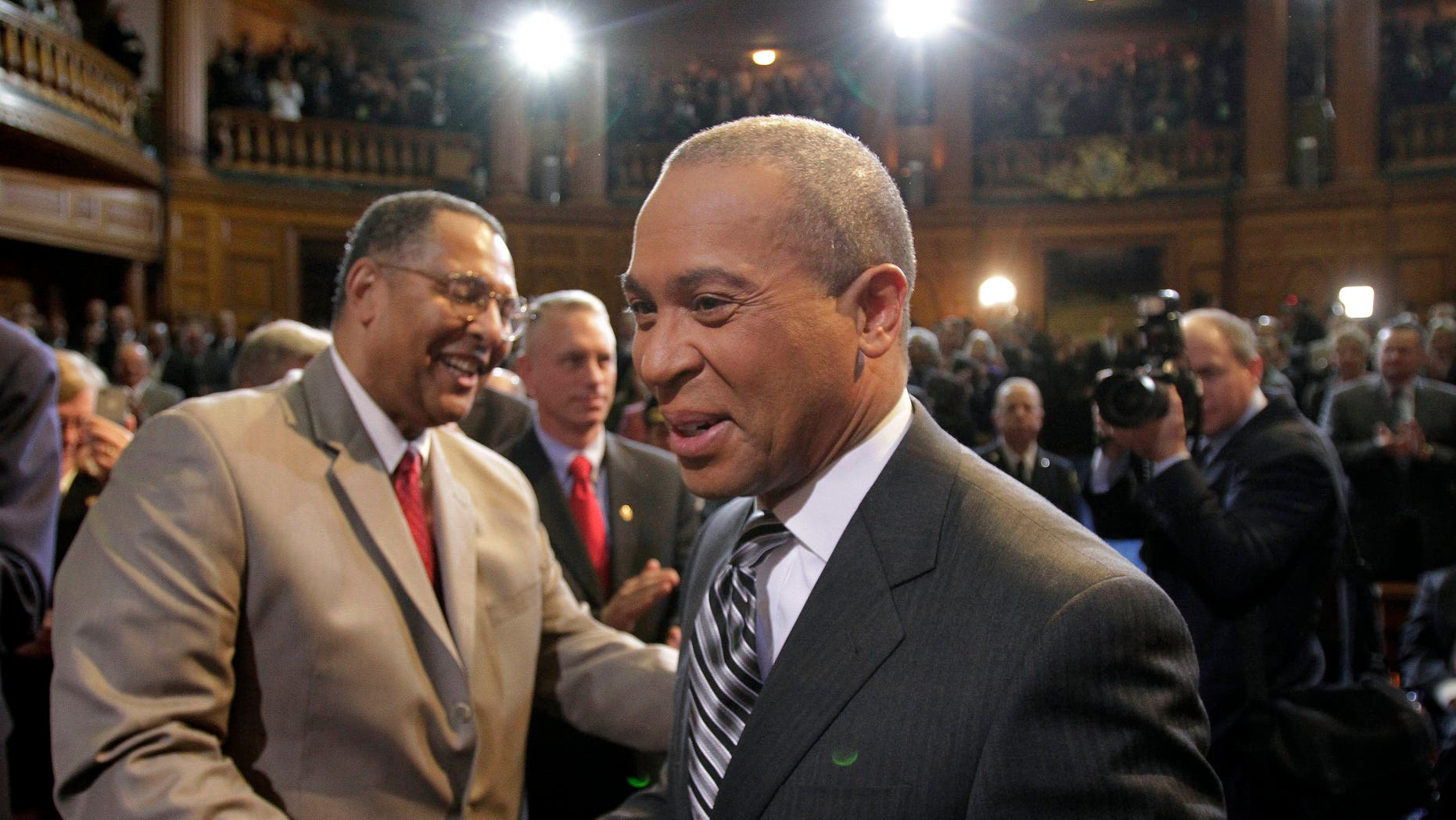 Jan. 6: Newly re-elected Massachusetts. Gov. Deval Patrick, right, is greeted by Chief Justice of the Massachusetts Supreme Court Roderick Ireland, left, as Patrick arrives in the House Chamber at the Statehouse, in Boston.