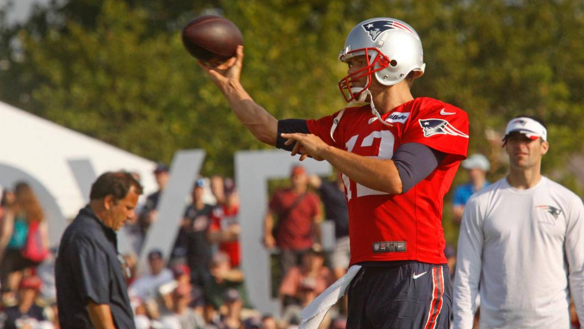New England Patriots NFL teams quarterback Tom Brady (12) throws during a joint training camp with the Washington Redskins in Richmond, Va., Wednesday, Aug. 6, 2014. (AP Photo/Jay Paul)