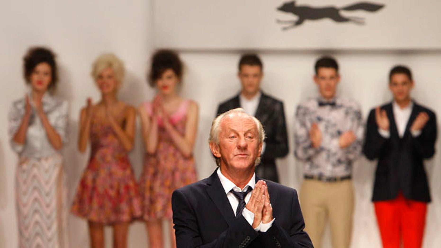 September 17: Designer Paul Costelloe is seen at the end of his show at London Fashion Week. (AP)