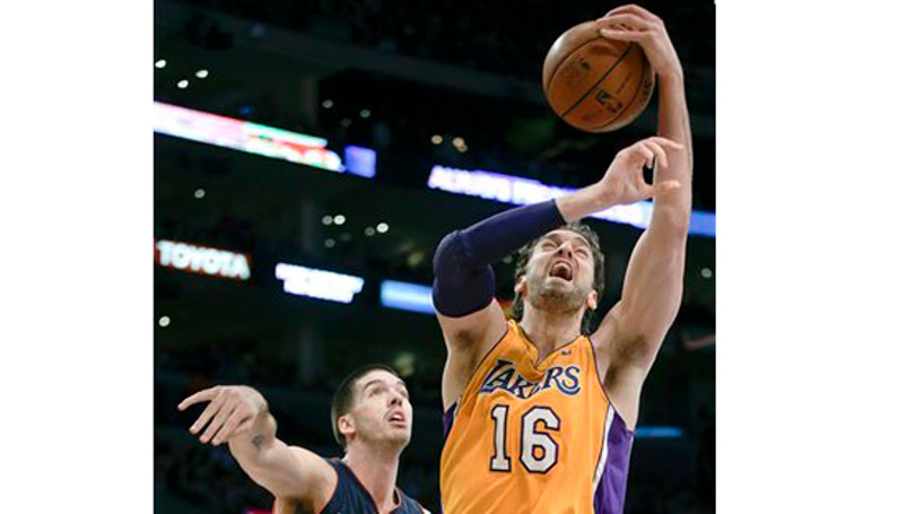 Los Angeles Lakers forward Pau Gasol, right, is fouled by Charlotte Bobcats center Byron Mullens during the first half of an NBA basketball game in Los Angeles, Tuesday, Dec. 18, 2012. (AP Photo/Chris Carlson)