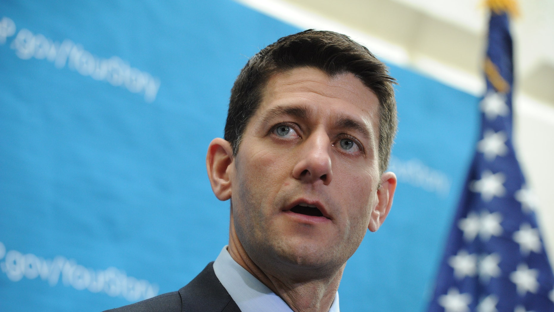 """WASHINGTON, DC - DECEMBER 11: Chairman of the House Budget Committee Rep. Paul Ryan (R-WI.) offers remarks while joined by others form the GOP leadership, during a media availability following a Republican Conference meeting at the U.S. Capitol, December 11, 2013, in Washington, DC. House Speaker John Boehner responded to conservative groups opposing the newly announced bipartisan budget deal, saying """"They're using our members and they're using the American people for their own goals. This is ridiculous."""" (Photo by Rod Lamkey/Getty Images)"""