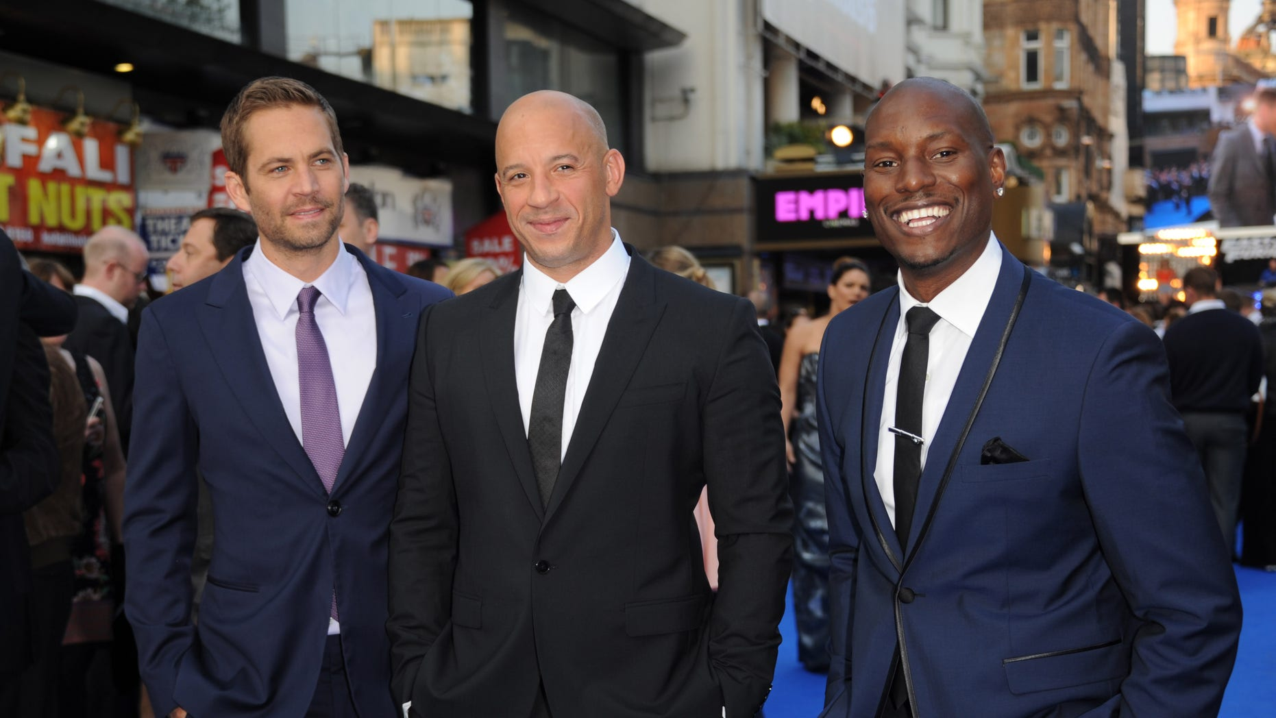 """LONDON, ENGLAND - MAY 07:  Actors Paul Walker, Vin Diesel and Tyrese Gibson attend the """"Fast & Furious 6"""" World Premiere at The Empire, Leicester Square on May 7, 2013 in London, England.  (Photo by Stuart C. Wilson/Getty Images for Universal Pictures)"""