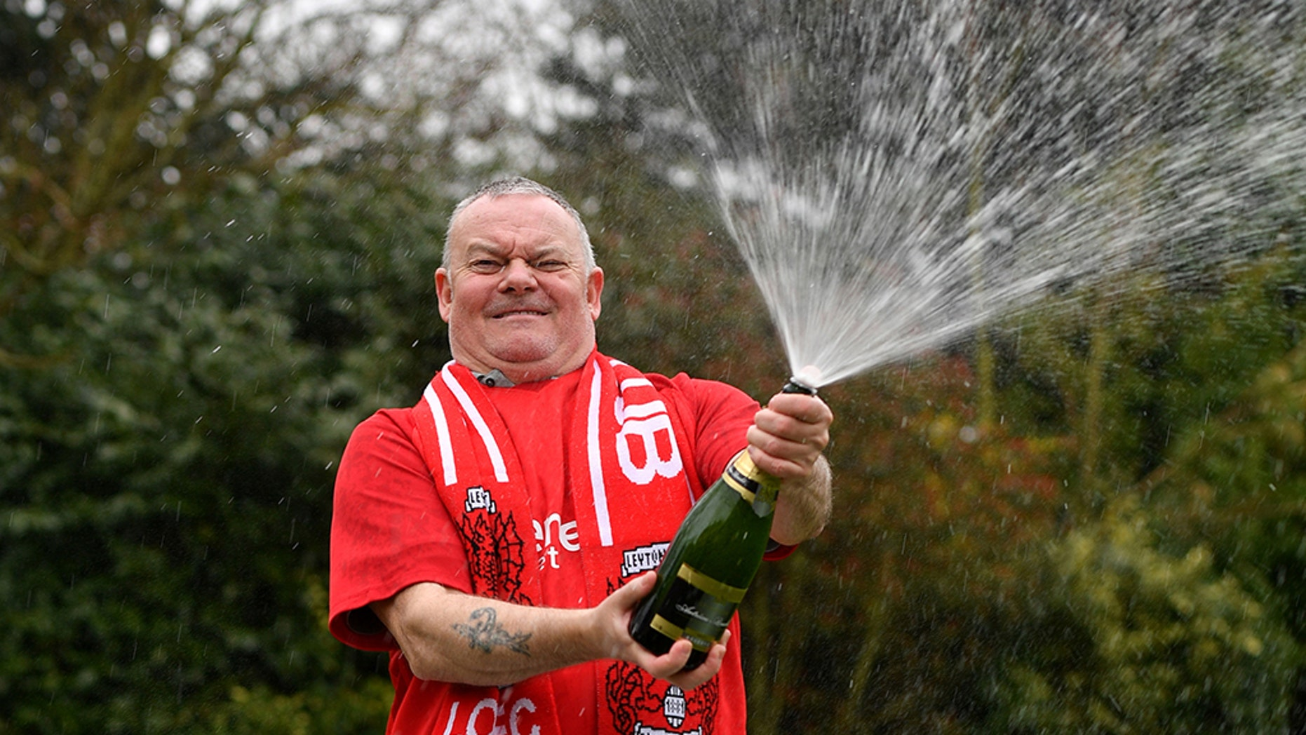 Paul Long celebrates after his Lucky Dip ticket matched all six numbers.