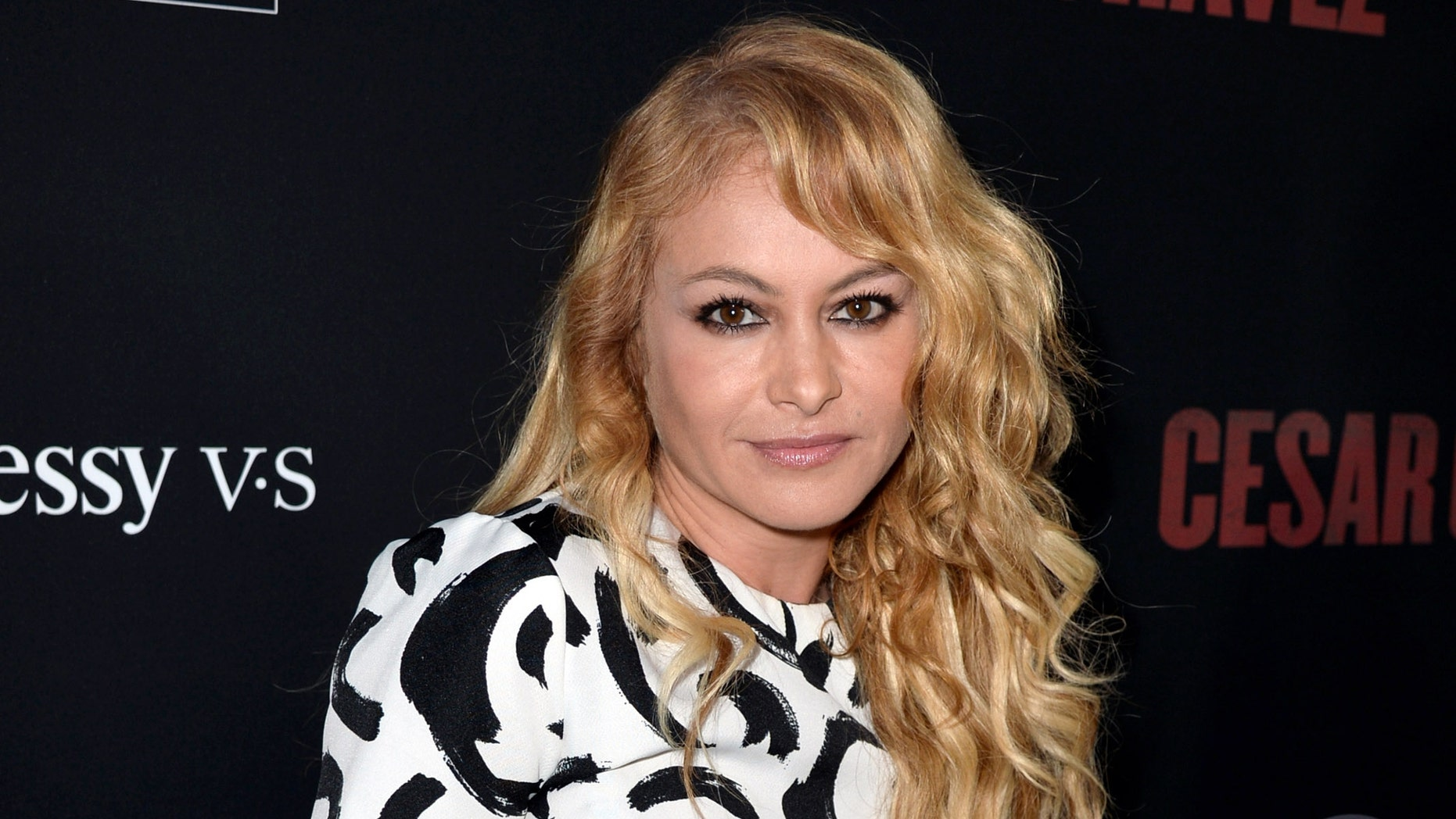 """LOS ANGELES, CA - MARCH 20:  Singer Paulina Rubio arrives at the premiere of Pantelion Films And Participant Media's """"Cesar Chavez"""" at the Chinese Theatre on March 20, 2014 in Los Angeles, California.  (Photo by Kevin Winter/Getty Images)"""