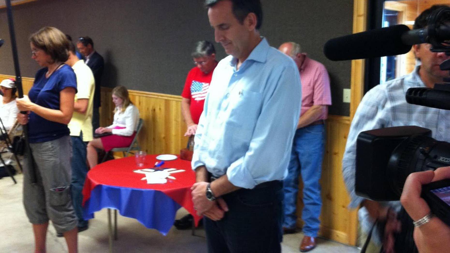Former Minnesota Governor Tim Pawlenty stands during a prayer at a Humboldt County GOP meeting August 9. (Fox News)