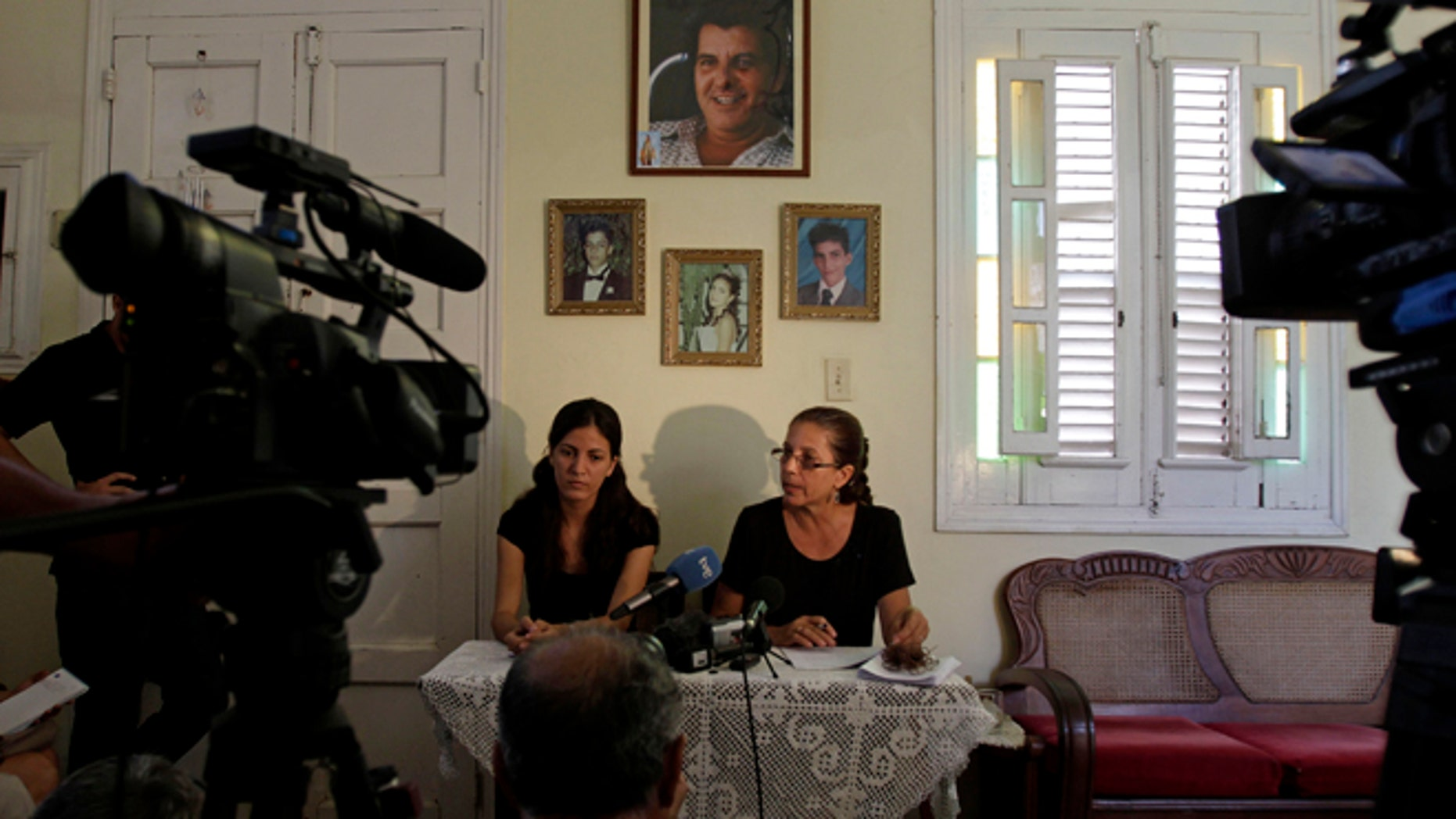 Ofelia Acevedo, right, widow of the late Cuban activist Oswaldo Paya and her daugther Rosa Maria Paya hold a news conference, in Havana, Cuba, Wednesday, Aug 1, 2012. Cuba has charged a Spanish citizen with the equivalent of vehicular manslaughter in the July 22 car accident that killed Acevedo's husband, a prominent dissident and another government opponent. (AP Photo/Franklin Reyes)