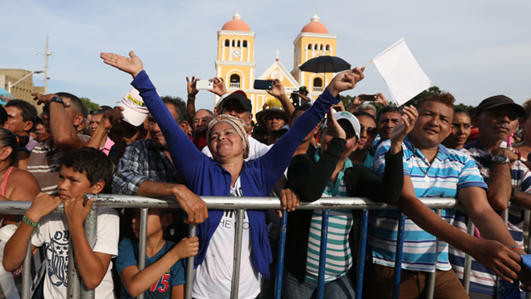 People enjoy a concert for peace in Carmen de Bolivar, Colombia, Sunday, Sept. 25, 2016. Colombia's government and the Revolutionary Armed Forces of Colombia, FARC, will sign a peace agreement to end over 50 years of conflict, in Cartagena, on Monday. (AP Photo/Fernando Vergara)