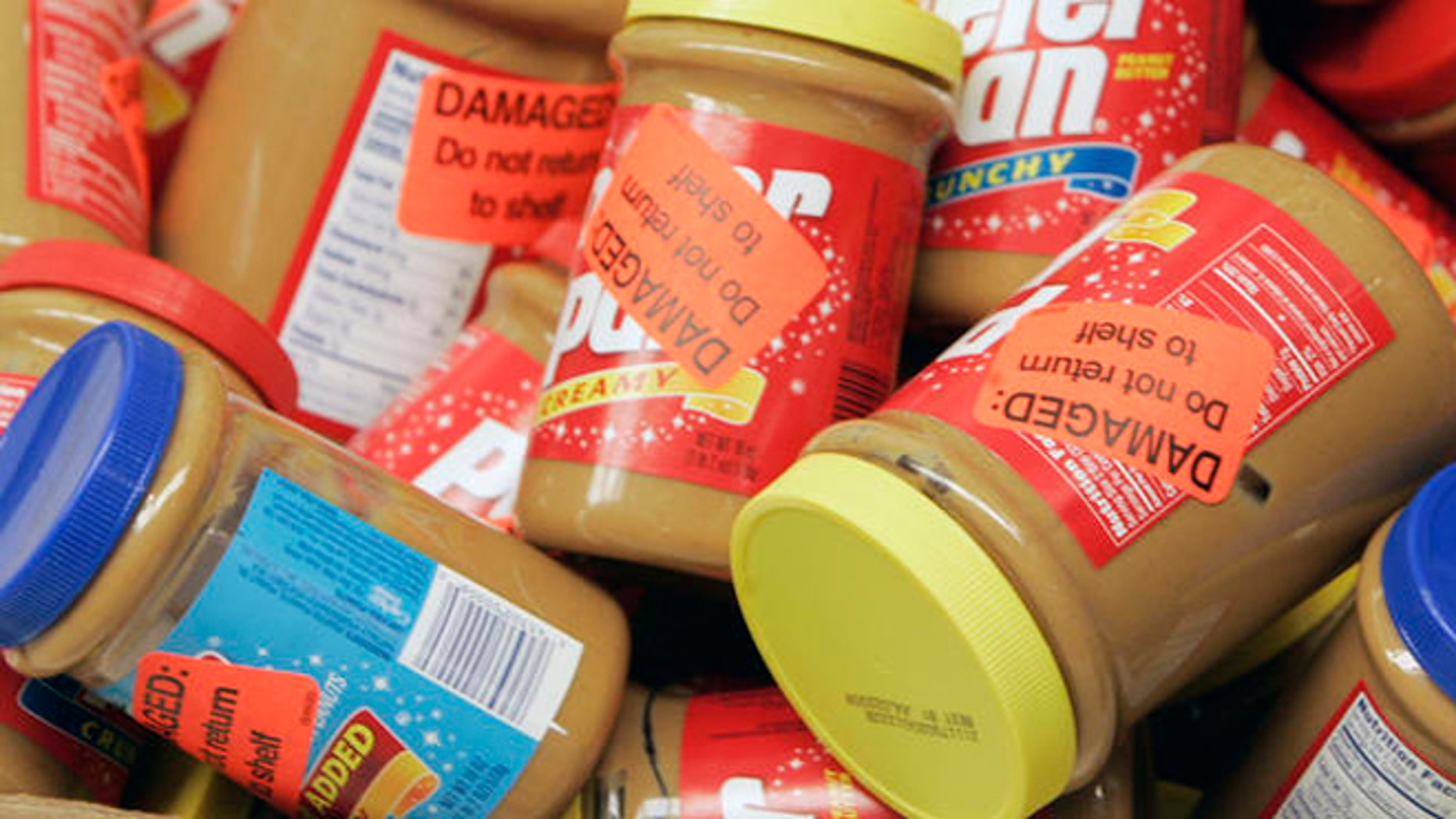 ** FILE **  Returned jars of Peter Pan Peanut Butter are shown at a super market, in this Feb. 16, 2007, file photo in Atlanta. ConAgra Foods Inc. has extended its recall of all peanut butter produced at a plant in Georgia by more than a year, back to October 2004, the Food and Drug Administration said Friday, March 9, 2007.  (AP Photo/John Bazemore, file)