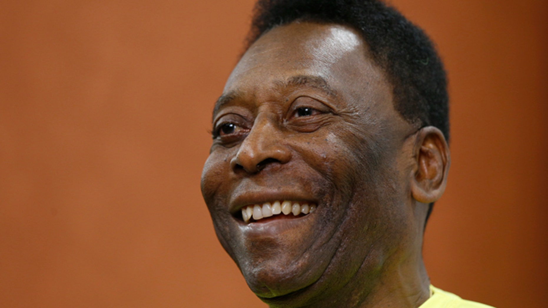 FILE - In this March 20, 2015 file photo, Brazilian soccer legend Pele smiles during a media opportunity at a restaurant in London. Pele said on Friday, Aug. 5, 2016 that his poor health will keep him from attending the opening ceremony of the Rio Olympics.  (AP Photo/Kirsty Wigglesworth, File)