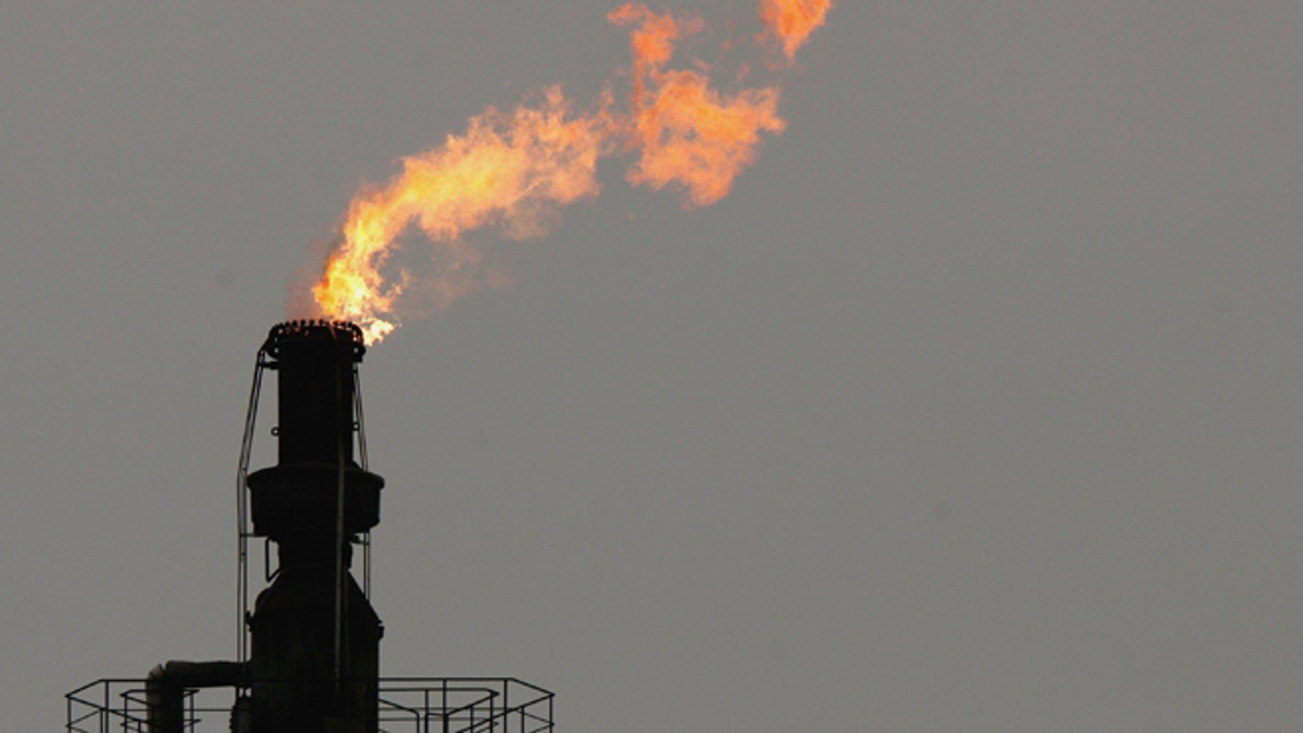 """SCHWEDT, GERMANY - JANUARY 09:  An exhaust flame burns at the PCK crude oil refinery January 9, 2007 near the Polish border in Schwedt, Germany. Crude oil from Russia has stopped flowing to the PCK refinery since 6:00 AM January 8 due to a row between Russia and Belarus over how much Belarus should pay for Russian oil. Initial reports claimed Belarus had turned off the flow of crude oil through the """"Druzhba"""" pipeline as a means to negotiate a better price. German oil reserves are still substantial, though Chancellor Angela Merkel announced her country must not depend too much on one source for its energy needs.  (Photo by Sean Gallup/Getty Images)"""