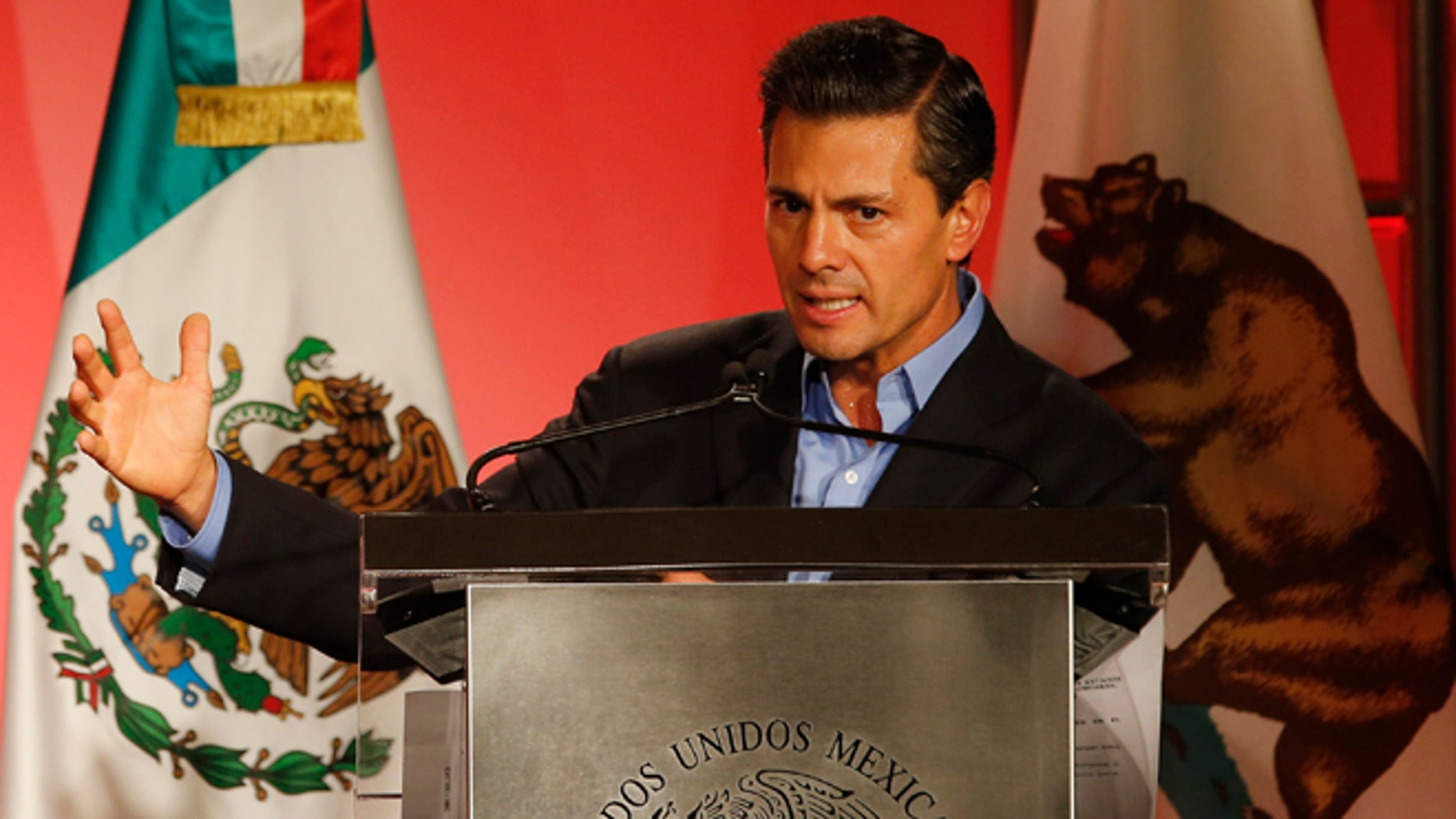 Mexico's President Enrique Pena Nieto speaks to Mexican-American community leaders and others in Los Angeles, Monday, Aug. 25, 2014. (AP Photo/Damian Dovarganes)