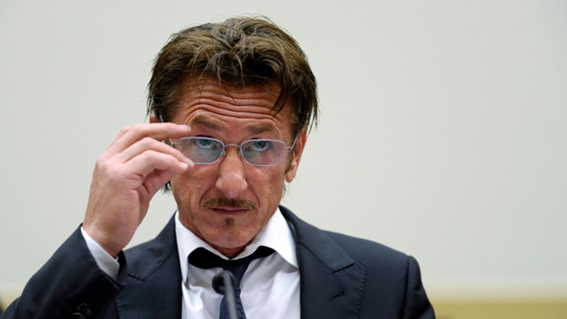 Academy Award-winning actor Sean Penn waits to testify on Capitol Hill in Washington, Monday, May 20, 2013.