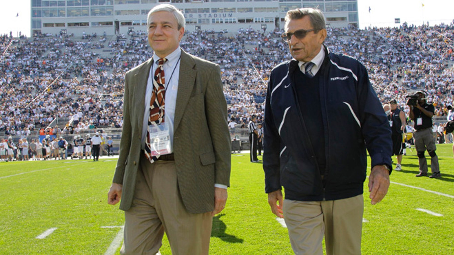 Oct. 8, 2011: This file photo shows Penn State president Graham Spanier, left, and head football coach Joe Paterno before a college football game against Iowa in State College, Pa.