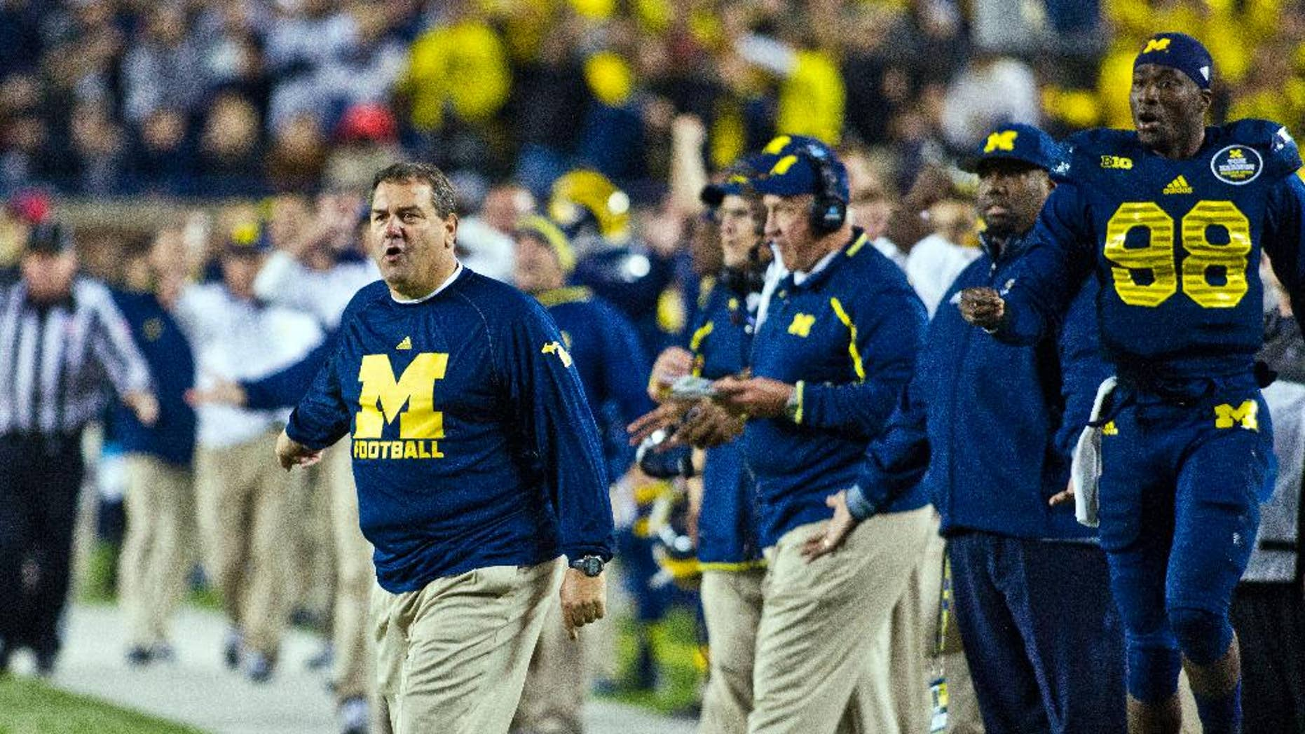 Michigan head coach Brady Hoke shouts and reacts on the sideline in the fourth quarter of an NCAA college football game against Penn State in Ann Arbor, Mich., Saturday, Oct. 11, 2014. Michigan won 18-13. (AP Photo/Tony Ding)