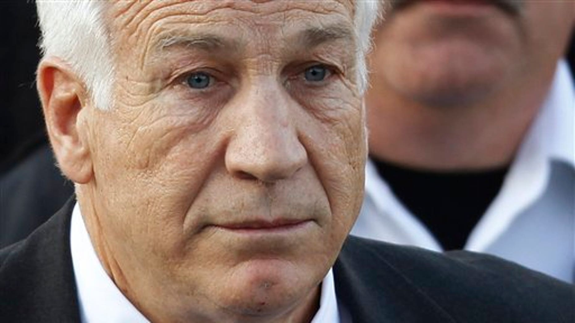 In this Dec. 13, 2011 file photo,Jerry Sandusky, the former Penn State assistant football coach charged with sexually abusing boys, leaves the Centre County Courthouse in Bellefonte, Pa.