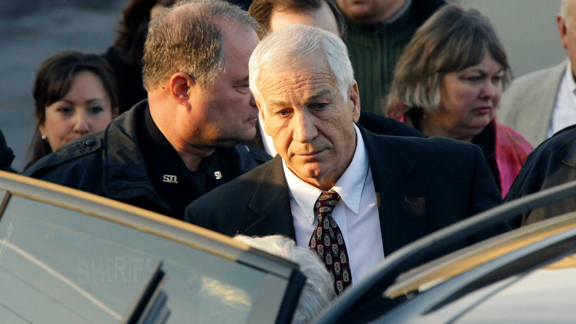 December 13: Former Penn State University assistant football coach Jerry Sandusky walks to his attorney's car as he leaves the Centre County Courthouse after waiving a preliminary hearing in Bellefonte, Pa.