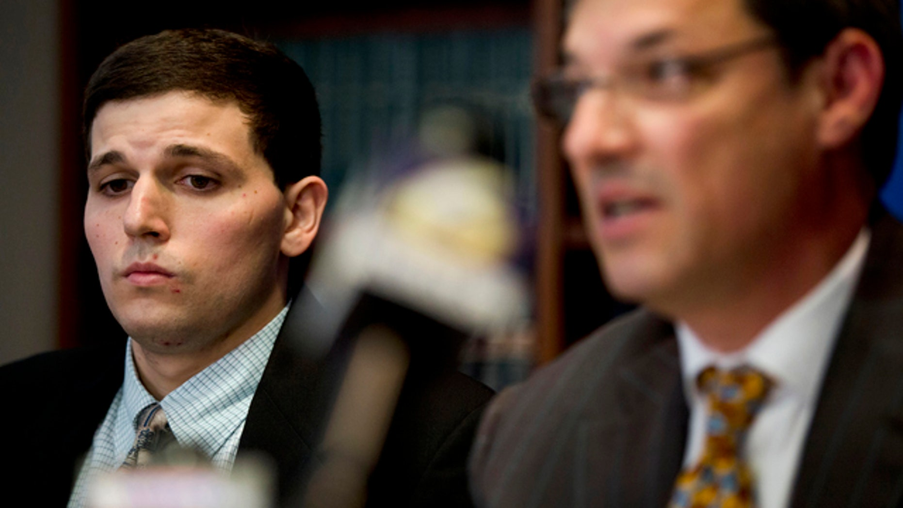 June 8, 2015: James Vivenzio, left, listens to his attorney Aaron J. Frewiald during a news conference in Philadelphia. Vivenzio, a former student who blew the whistle on a Penn State fraternity's secret Facebook page featuring photos of naked women says the university ignored his complaints about sexual assault, hazing and drug use. (AP Photo/Matt Rourke)