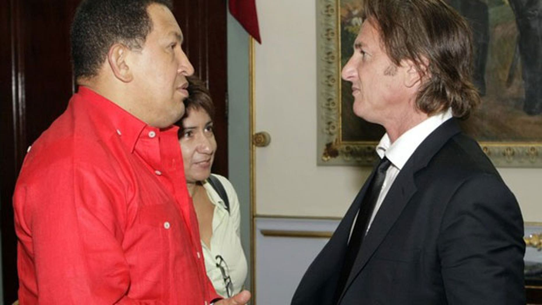 Oct. 2009: Sean Penn (r) chats with Venezuelan President Hugo Chavez at Miraflores Palace in Caracas.
