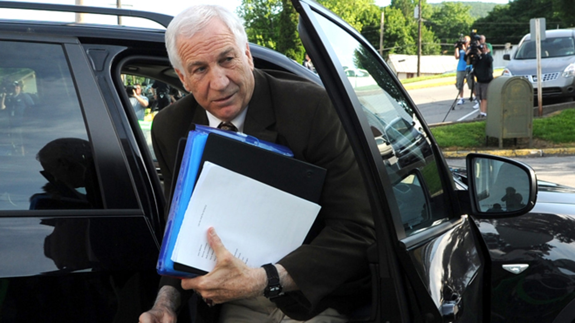 June 14: Former Penn State University assistant football coach Jerry Sandusky arrives for the fourth day of his trial at the Centre County Courthouse in Bellefonte, Pa.