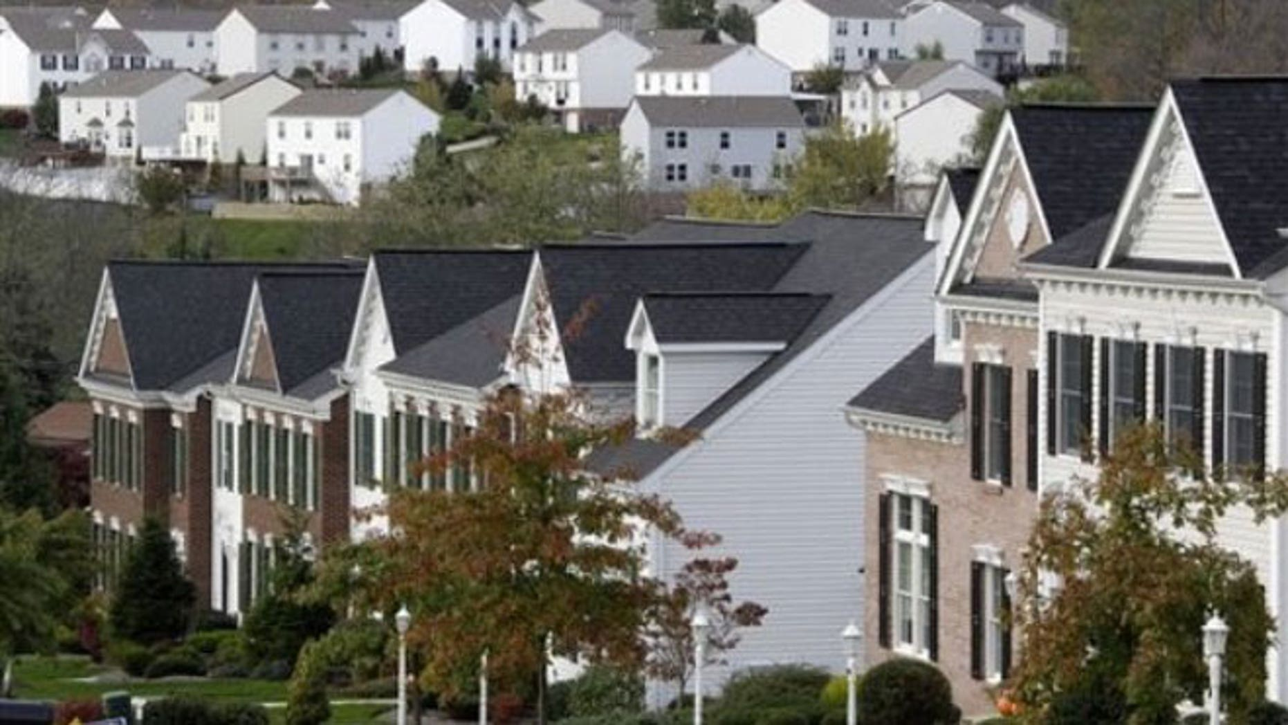 This Oct. 18, 2011 file photo, shows two home developments in the Pittsburgh suburb Canonsburg, Pa. For the first time in a century, America's largest cities are growing at a faster rate than their surrounding suburbs.