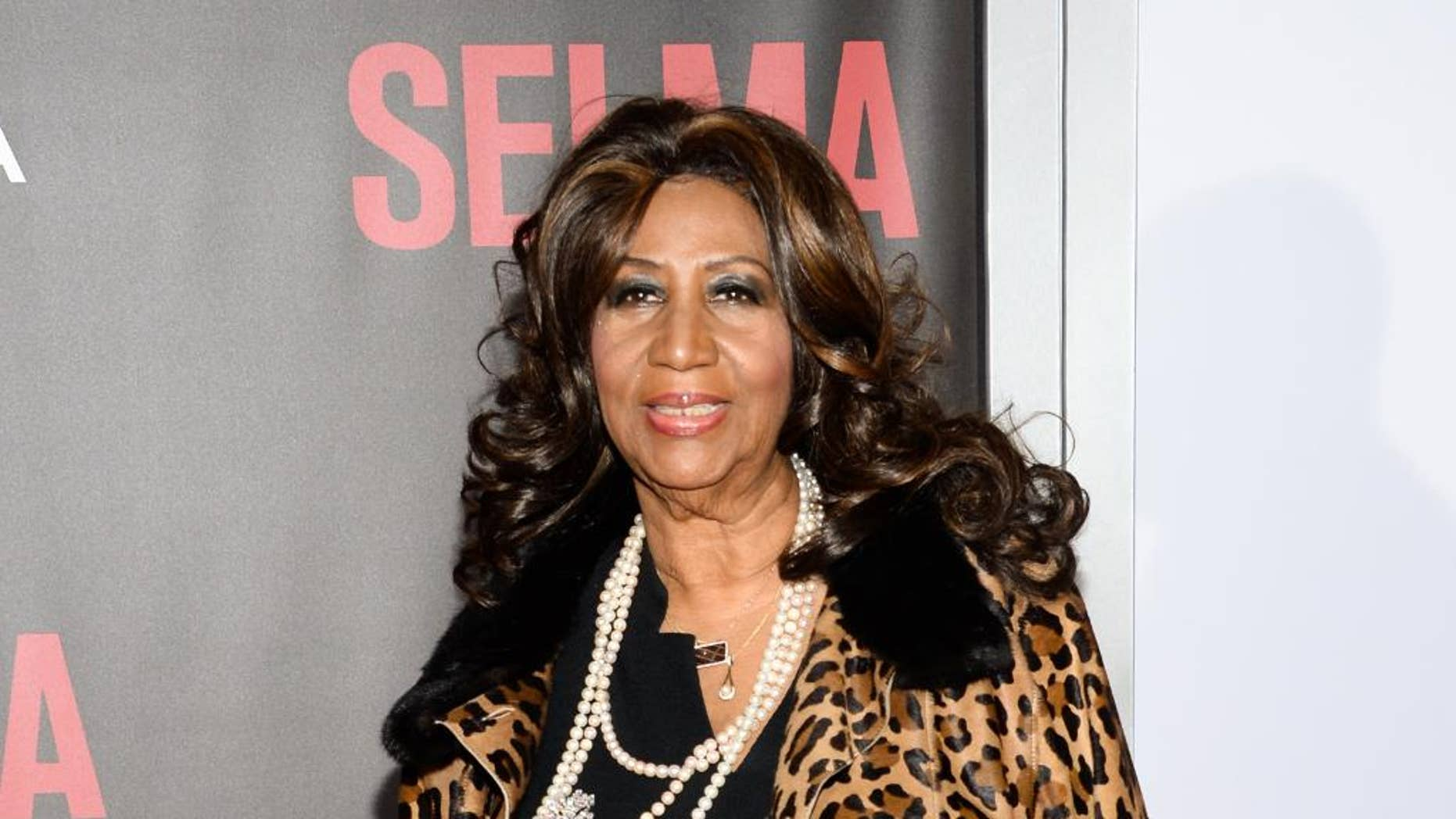 """FILE - In this Dec. 14, 2014 file photo, singer Aretha Franklin attends the premiere of """"Selma"""" in New York. Franklin is canceling her Friday night show in Las Vegas because of exhaustion. The 73-year-old said in a statement Tuesday, Aug. 11, 2015, that she has to reschedule the show at The Colosseum at Caesars Palace after driving her bus from Detroit to the West Coast for concerts. (Photo by Evan Agostini/Invision/AP, File)"""