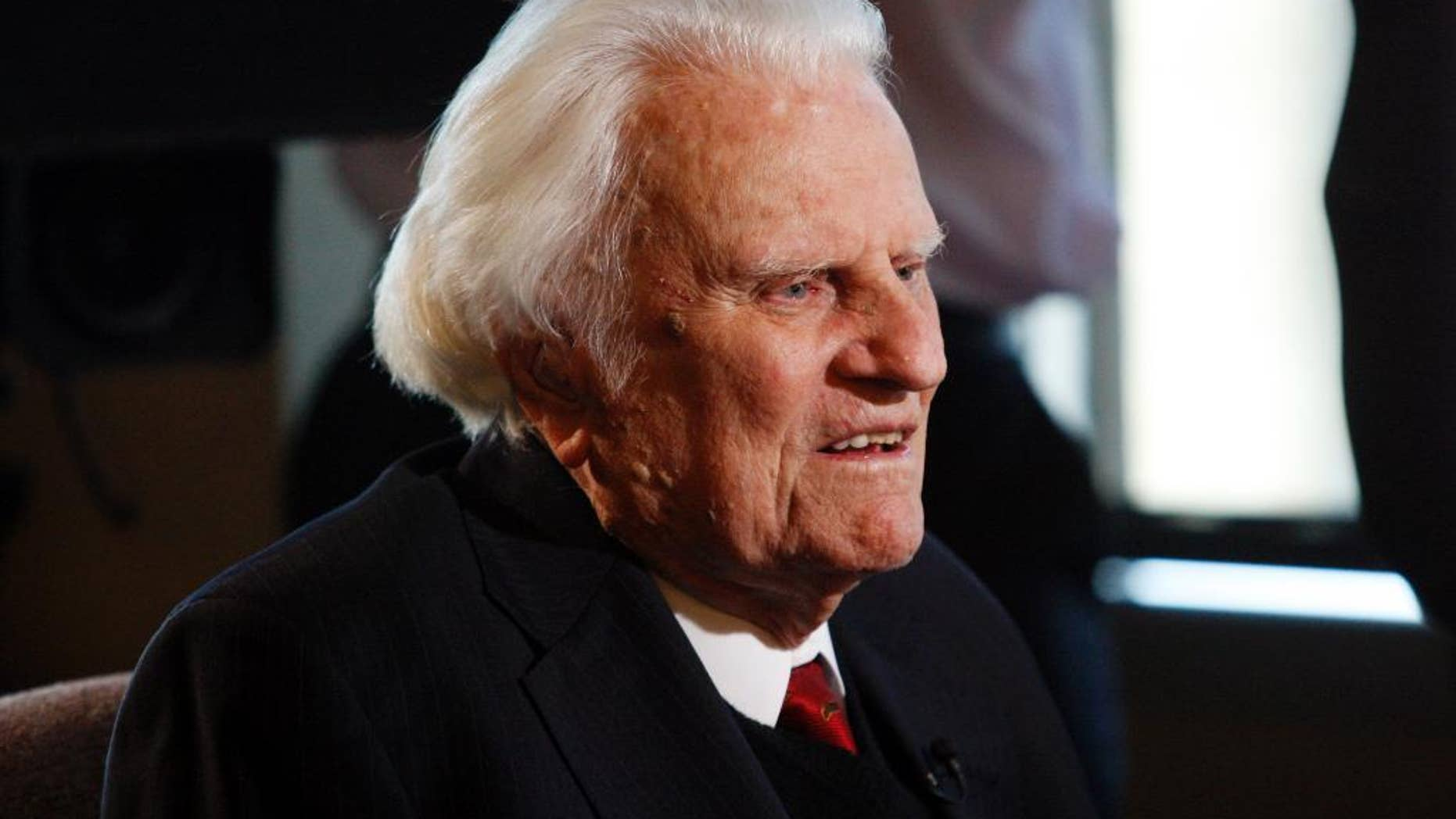 FILE - In this Dec. 20, 2010, file photo, Rev. Billy Graham is interviewed at the Billy Graham Evangelistic Association headquarters in Charlotte, N.C. Graham plans to celebrate his 96th birthday, on Friday, Nov. 7, 2014, with family and friends. Last year, 900 people attended a two-hour party for Graham at an Asheville hotel. His son, the Rev. Franklin Graham, said Wednesday that his father is in good spirits, he's eating well, and his mind is still sharp. (AP Photo/Nell Redmond, File)