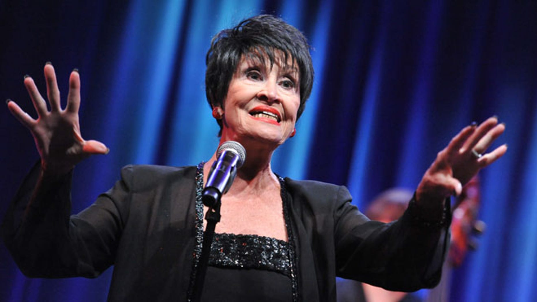 FILE - In a Sunday, Aug. 2, 2015 file photo, Chita Rivera performs during the âChita Rivera: A Lot of Livinâ to Doâ segment of the PBS 2015 Summer TCA Tour held at the Beverly Hilton Hotel in Beverly Hills, Calif. Rivera postponed her show at at Cafe Carlyl after being injured in a fall over the Christmas holiday. Rivera, who was to appear at the legendary venue on Jan. 12-23, will now take the stage from April 19-30 as she recovers from a pelvic stress fracture. (Photo by Richard Shotwell/Invision/AP, File)