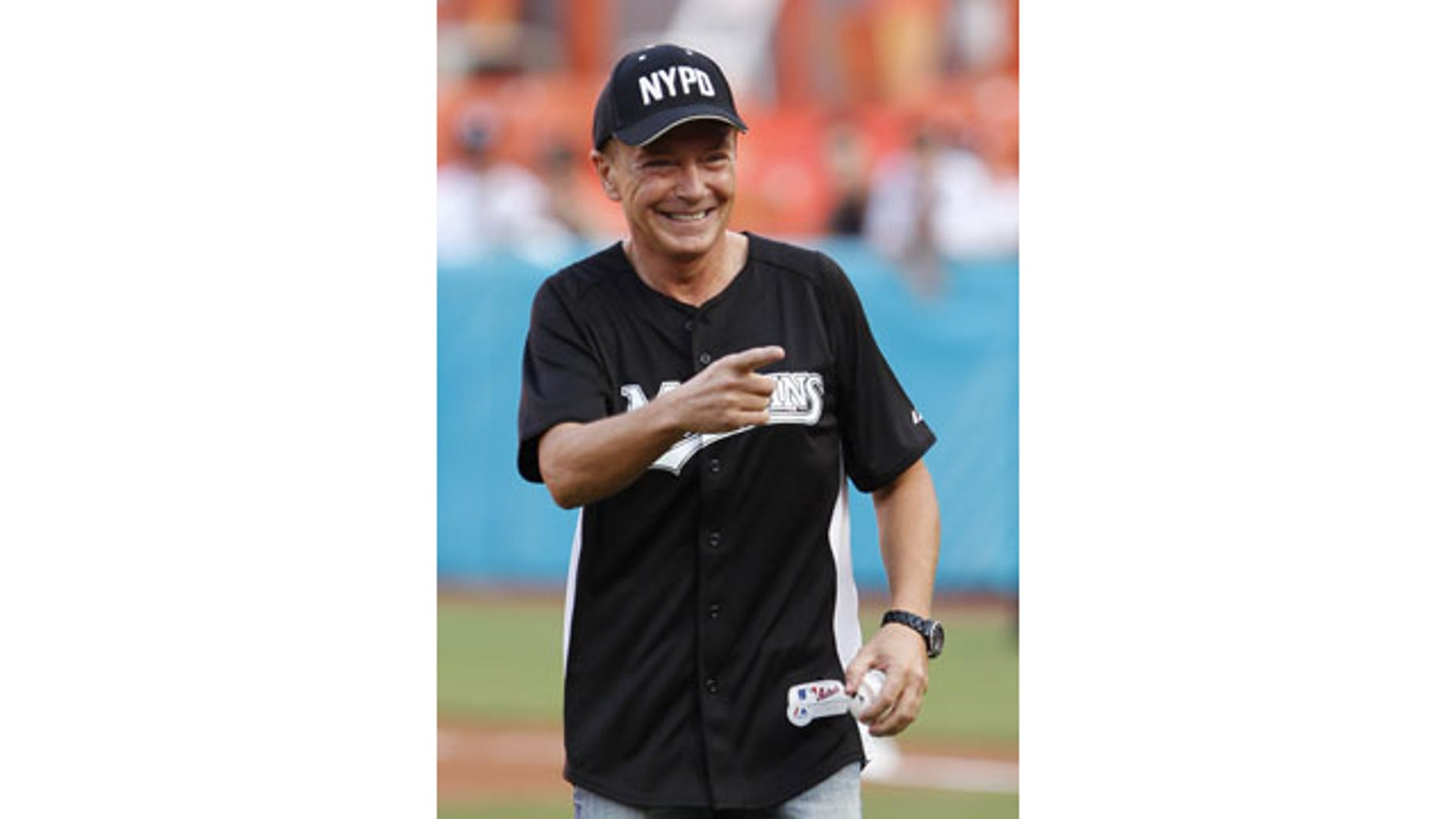 FILE - This July 9, 2011 file photo shows actor David Cassidy after throwing out a ceremonial first pitch before a baseball game between the Florida Marlins and the Houston Astros, in Miami. (AP Photo)