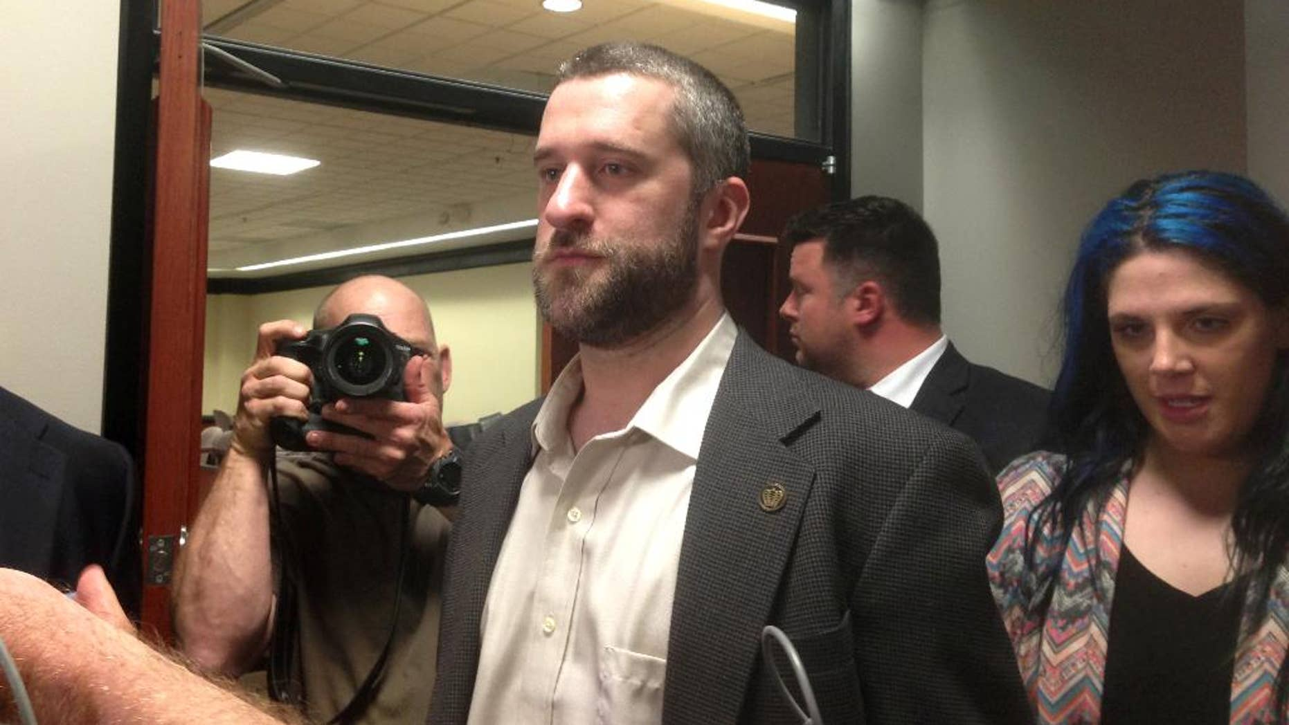 """FILE - In this May 29, 2015, file photo, television actor Dustin Diamond, center, leaves court in Port Washington, Wisc., after being convicted of two misdemeanors stemming from a barroom fight on Christmas Day 2014. Diamond, of """"Saved by the Bell"""" fame, is set to be sentenced Thursday, June 25, 2015. (AP Photo/Dana Ferguson, File)"""