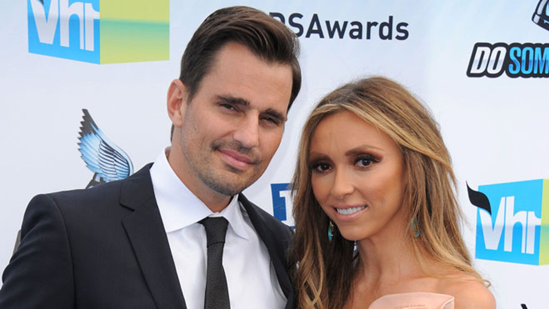Aug. 19, 2012: This file photo shows Bill Rancic, left, and his wife Giuliana Rancic attending the 2012 Do Something awards in Santa Monica, Calif.