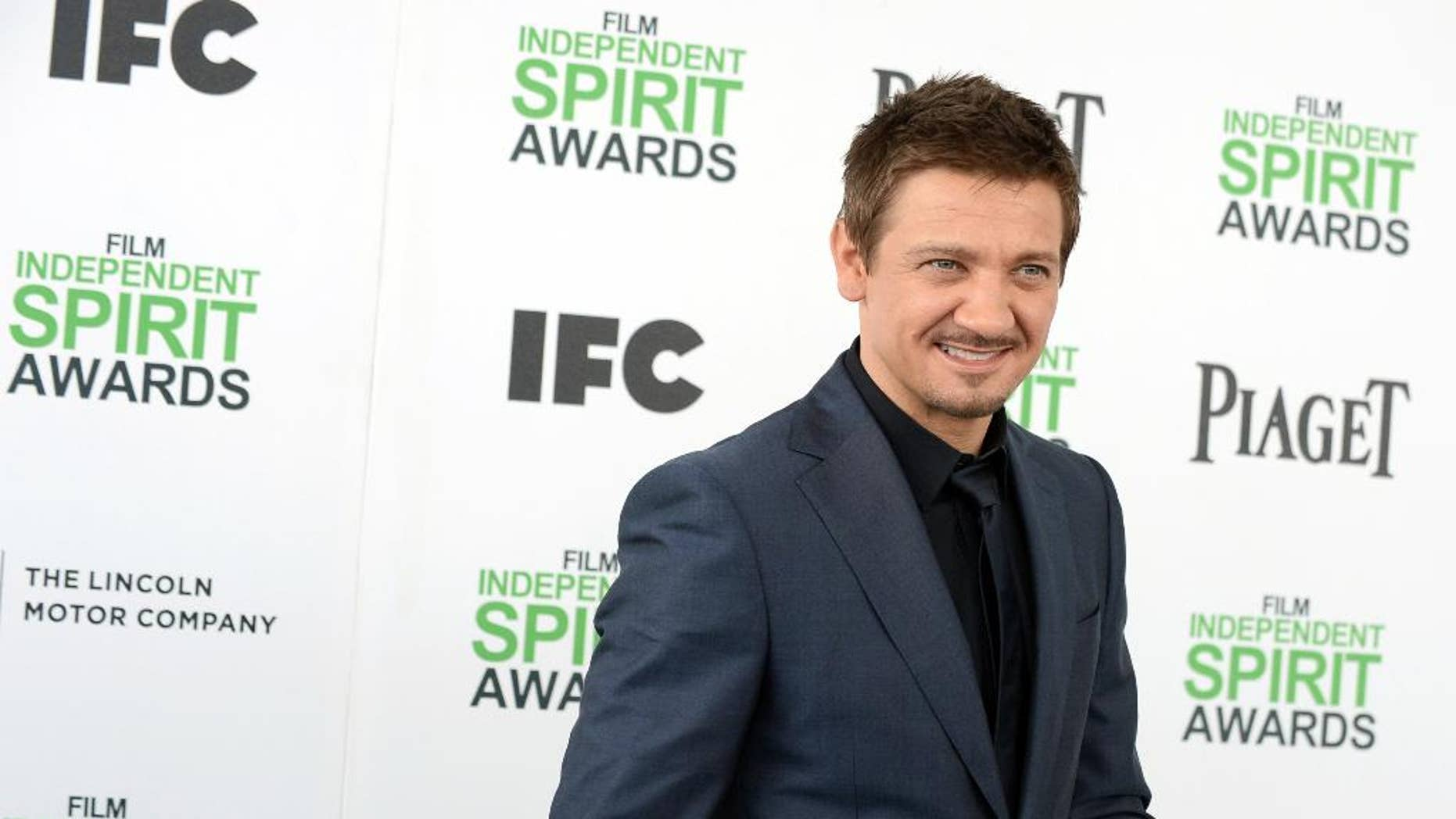 FILE - In this March 1, 2014 file photo, Jeremy Renner arrives at the 2014 Film Independent Spirit Awards, in Santa Monica, Calif.  Attorneys for Renner and his estranged wife, model Sonni Pacheco, told a Los Angeles judge on Wednesday, April 1, 2015, that the pair had settled a custody dispute over their 2-year-old daughter. Pacheco filed for divorce from the two-time Academy Award nominee in December, less than a year after their wedding. (Photo by Jordan Strauss/Invision/AP, File)