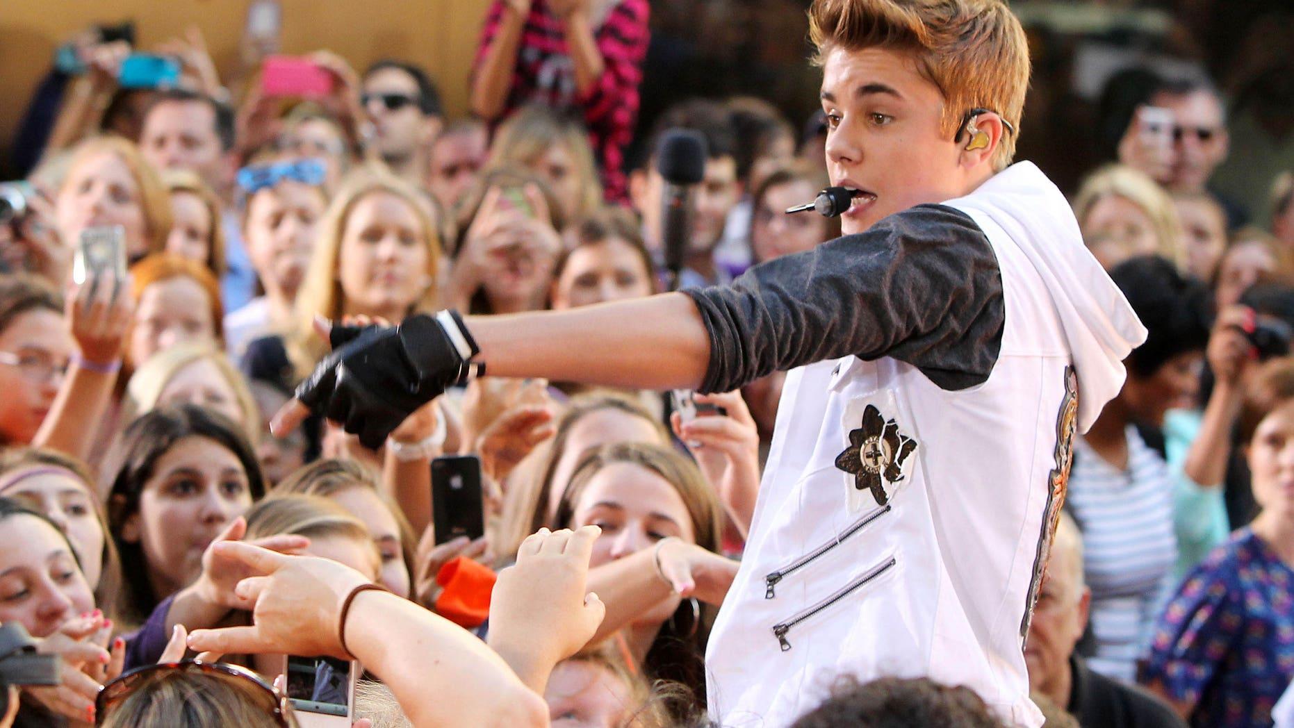 "Justin Bieber garnered his fourth number one album this week with his new release, ""Believe"". (AP Photo/Starpix, Amanda Schwab)"
