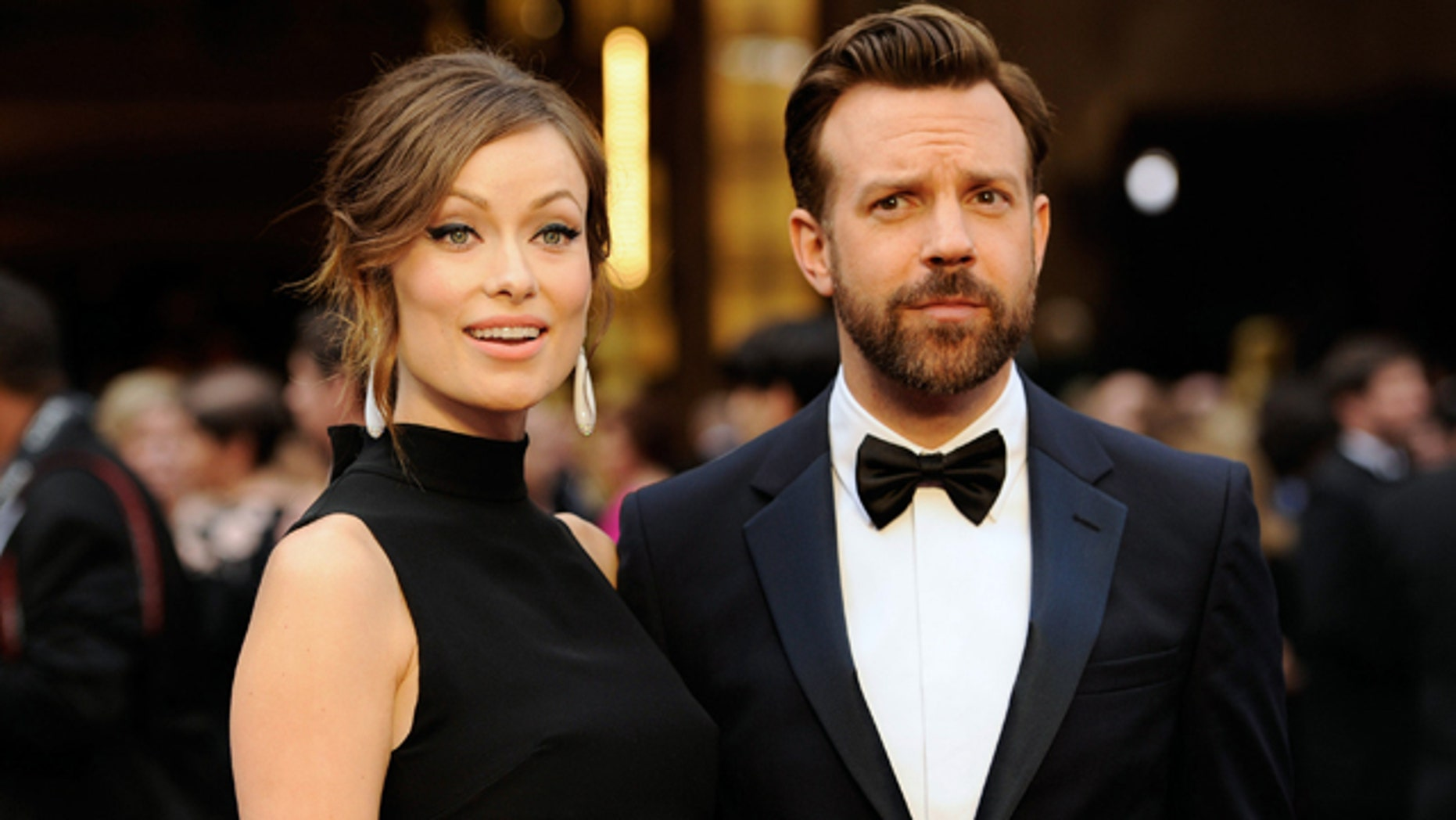 FILE - In this Sunday, March 2, 2014 file photo, Olivia Wilde, and Jason Sudeikis arrive at the Oscars at the Dolby Theatre in Los Angeles. (Photo by Chris Pizzello/Invision/AP, file)