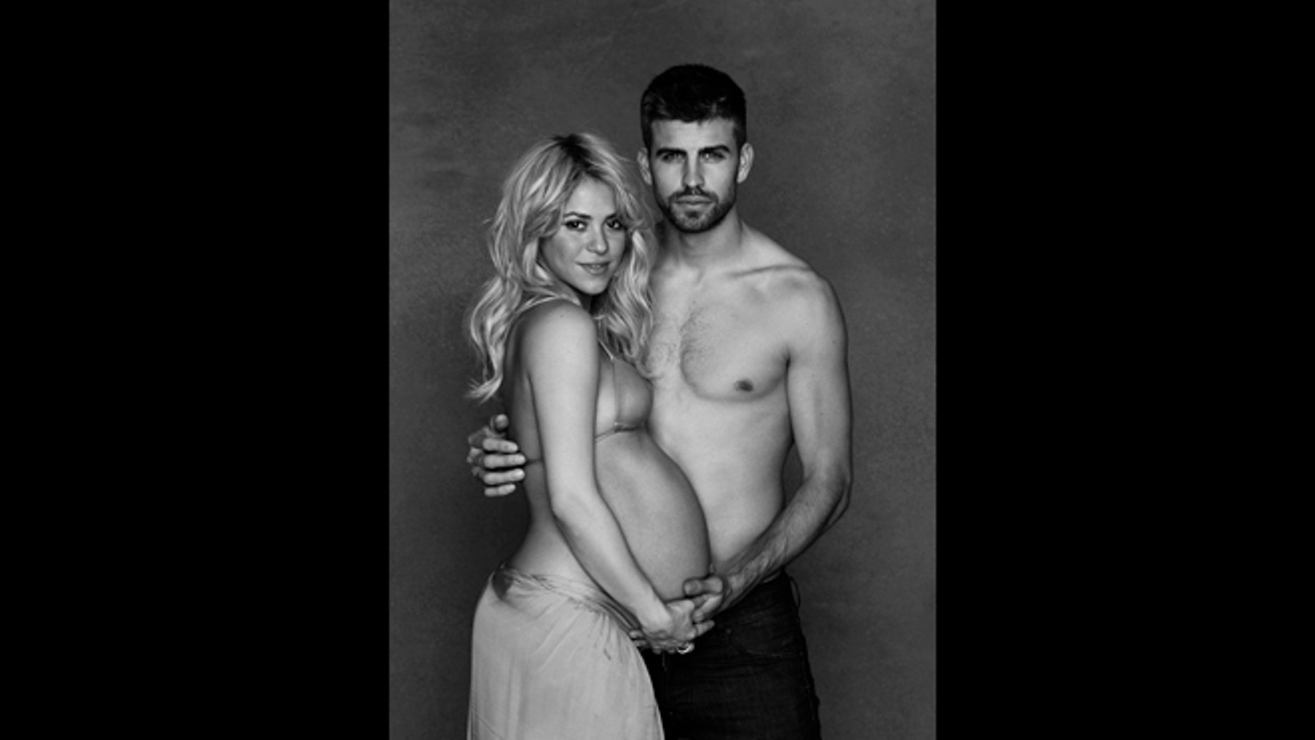This December 2012 image released courtesy of singer and UNICEF Goodwill Ambassador Shakira shows her posing with FC Barcelona star Gerard Piqué.