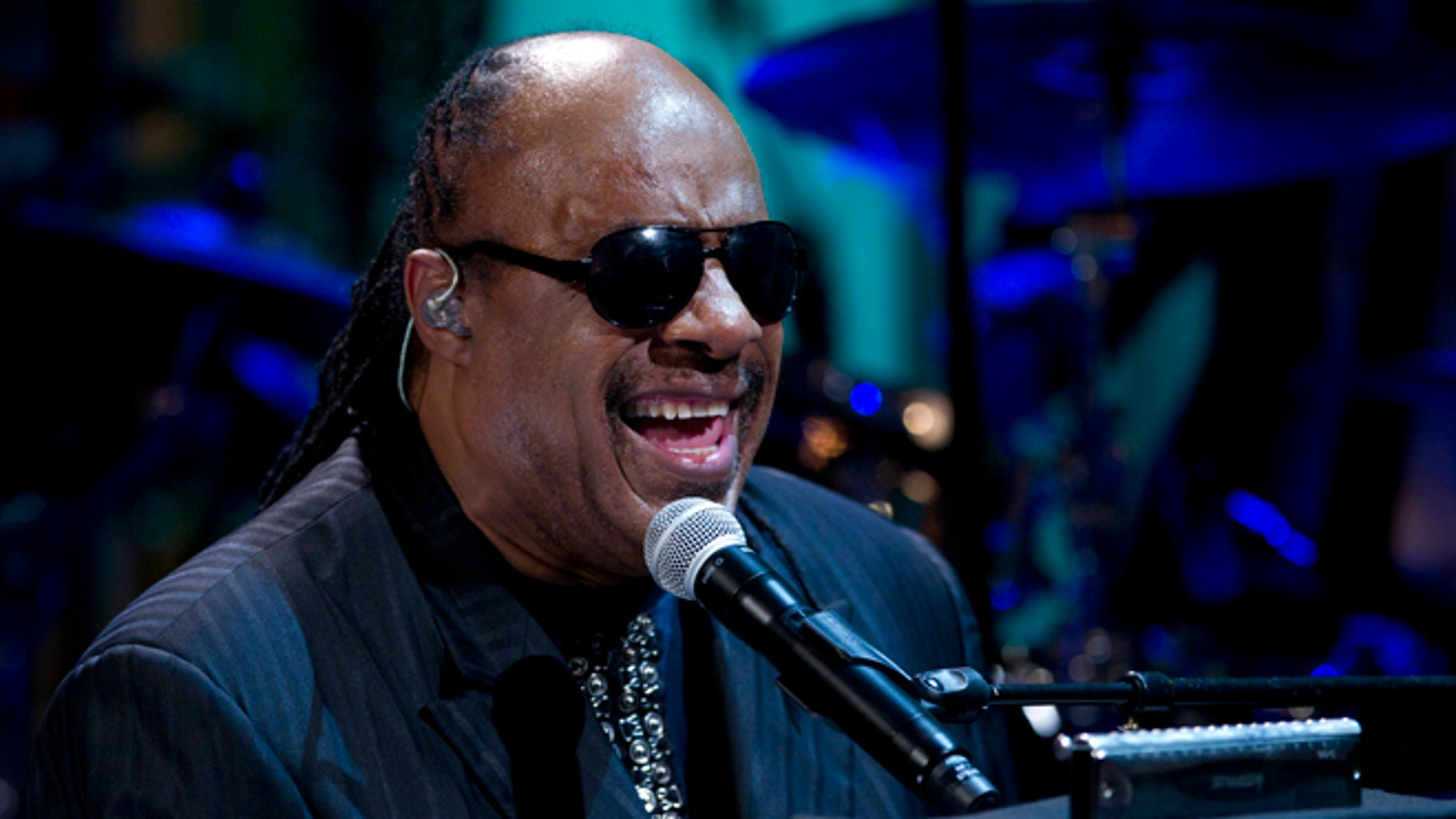 """May 9, 2012 file photo, Stevie Wonder performs during the """"In Performance at the White House"""" in the East Room of the White House in Washington, honoring songwriters Burt Bacharach and Hal David."""