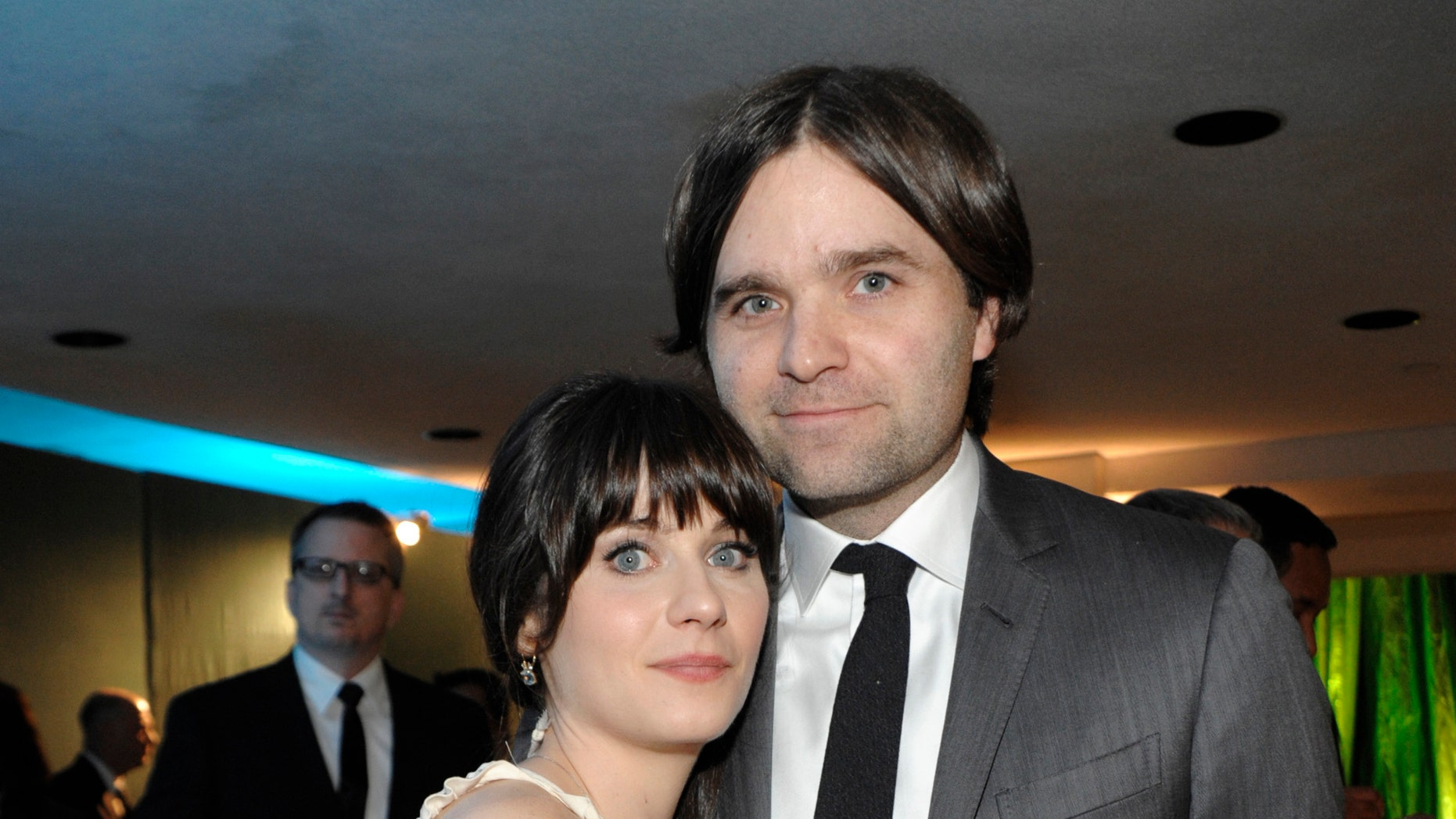 Jan. 16, 2011: File photo, actress Zooey Deschanel, left, and her husband, singer Ben Gibbard attend the 2011 HBO Golden Globe Party in Beverly Hills, Calif. Court records show a Los Angeles judge finalized the former couple's divorce on Dec. 12, 2012. The pair were married in 2009 and separated in October 2011.