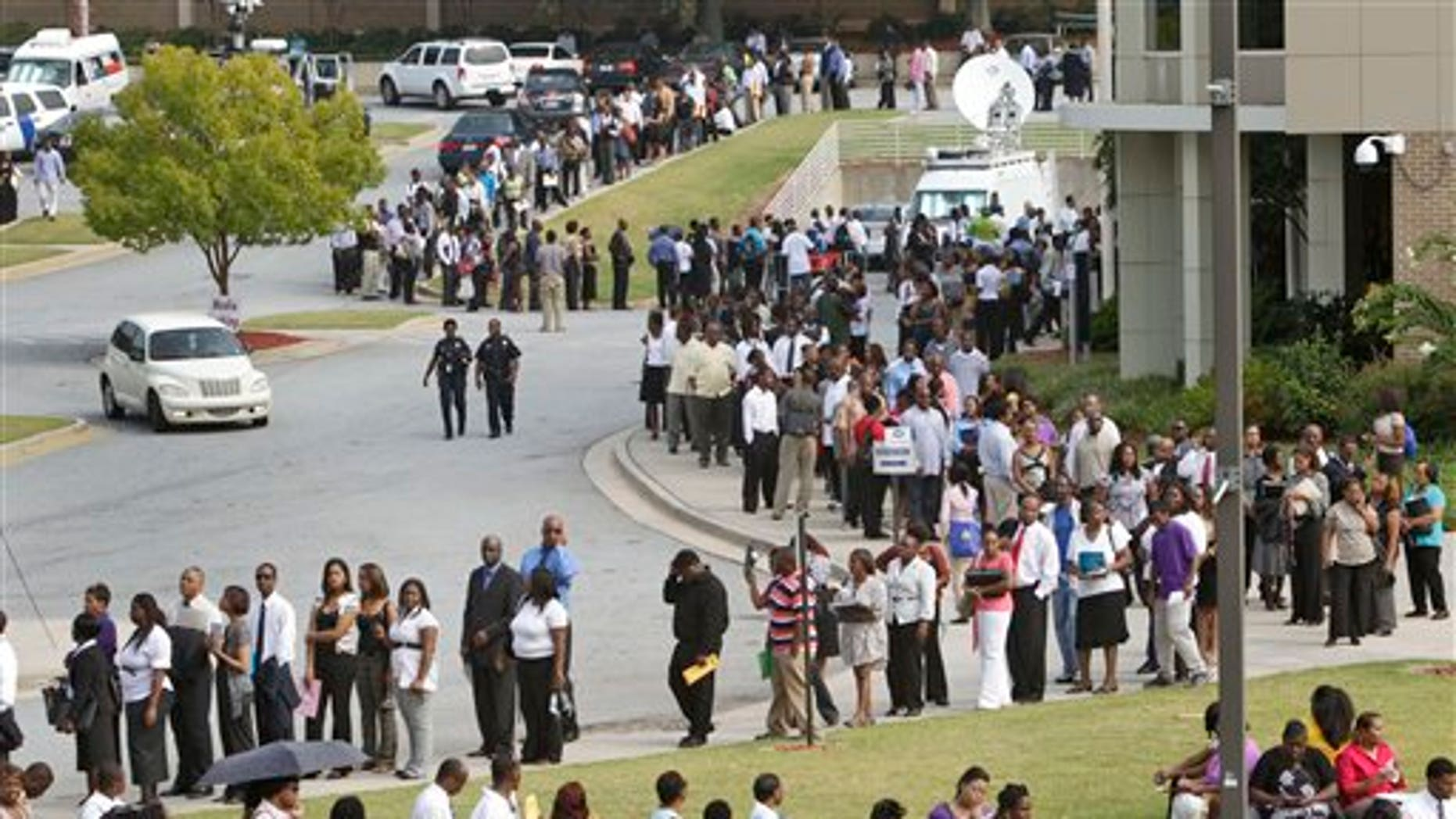 August 18: People wait in line during a job fair, sponsored by the Congressional Black Caucus on the campus of Atlanta Technical College in Atlanta, Georgia.