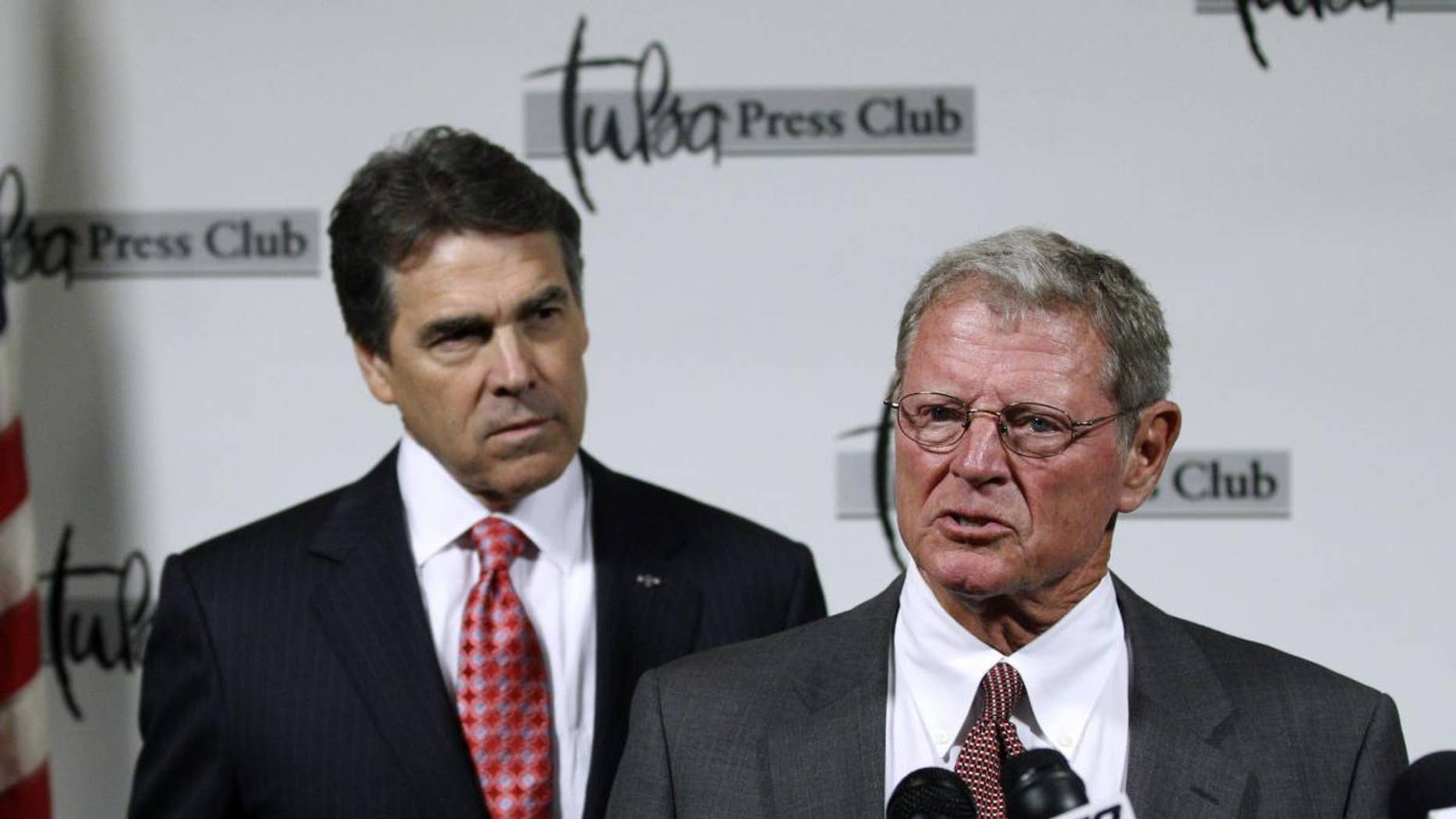 Sen. Jim Inhofe, R-Okla., right, introduces Republican presidential candidate, Texas Gov. Rick Perry, at a news conference in Tulsa, Okla., Monday, Aug. 29, 2011. (AP Photo/Sue Ogrocki)