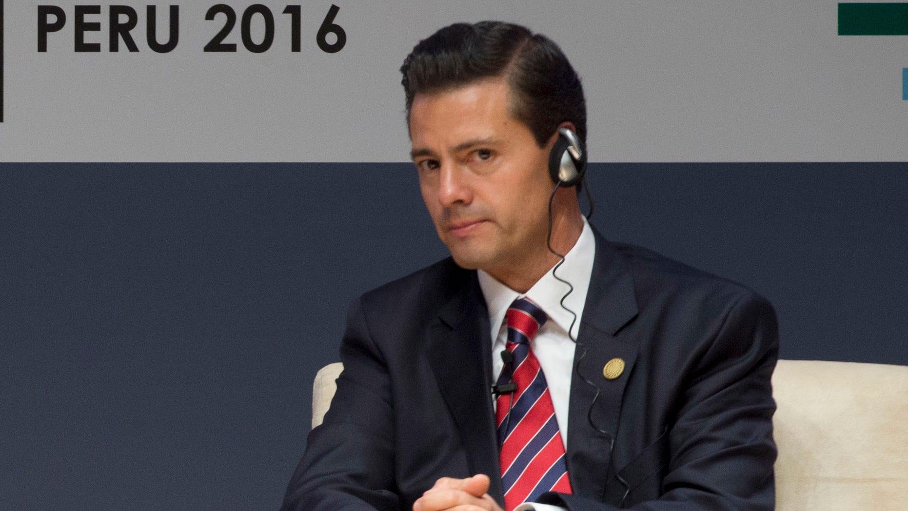 New Zealand's Prime Minister John Key, left, and Mexico's President Enrique Pena Nieto, patucipate in a forum about trade at the Asia Pacific Economic Cooperation, APEC, CEO Summit, in Lima, Peru, Saturday, Nov. 19, 2016. (AP Photo/Esteban Felix)