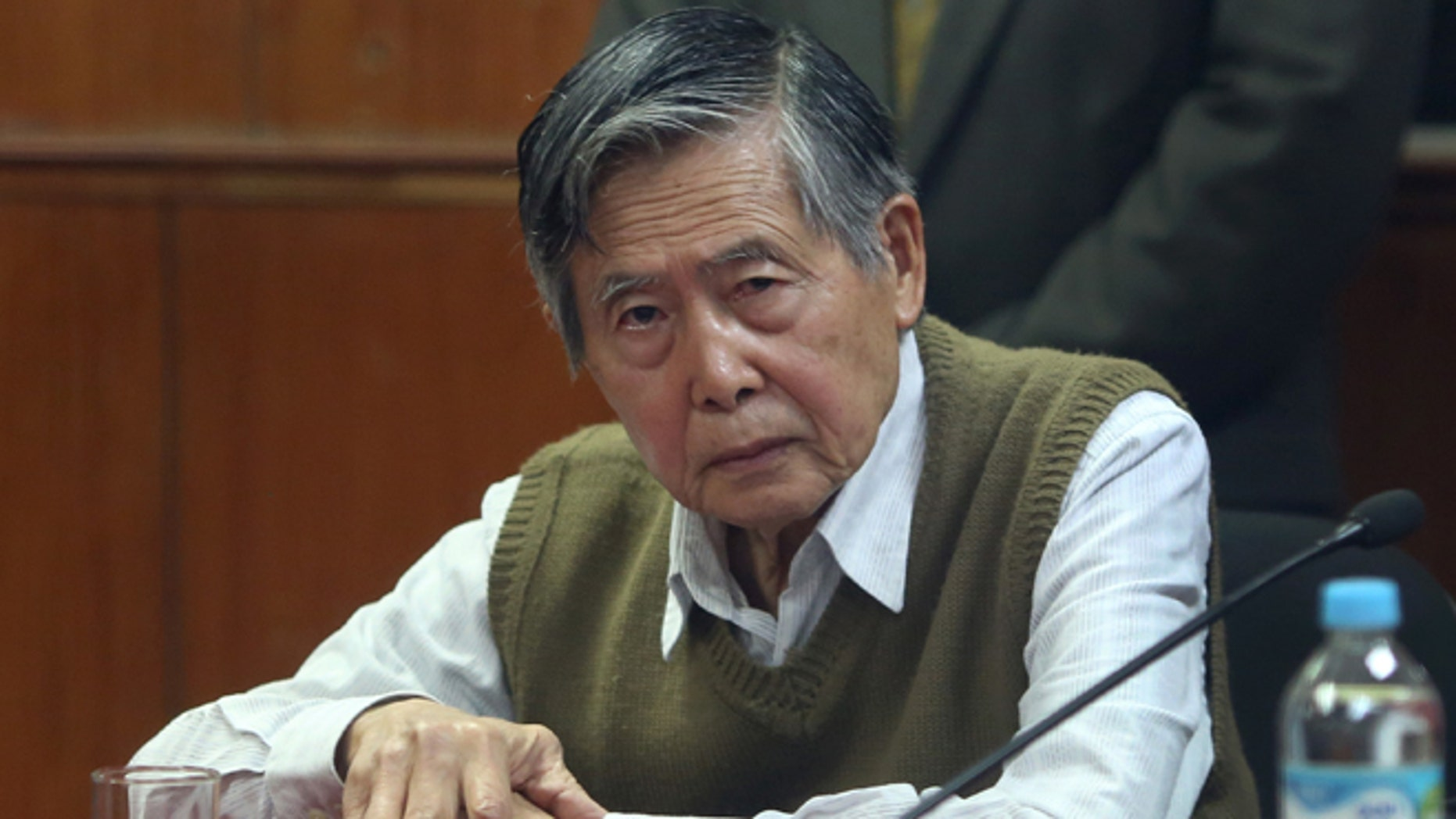 FILE - In this Oct. 29, 2013 file photo, jailed former President Alberto Fujimori attends a hearing at a police base on the outskirts of Lima, Peru. Many of the nations rural, indigenous poor have flocked to the support of his daughter Keiko, who is running for president, grateful for her fathers success in routing guerrillas who preyed on their communities. But tens of thousands have marched in the streets of the capital against the return of any Fujimori, haunted by the memory of the elders bloody crackdown on dissent and corrupt government, which have him serving 25 years in prison. Peru holds its presidential election on June 5, 2016.  (AP Photo/Martin Mejia, File)