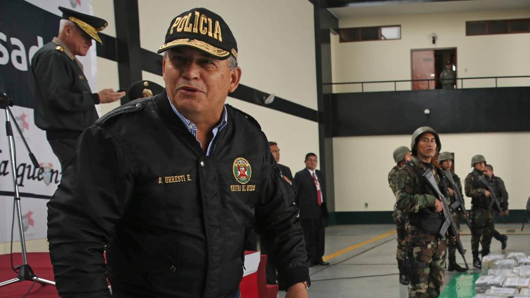 FILE - In this Sept. 1, 2014 file photo, Peru's Interior Minister Daniel Urresti talks with the press during the presentation of seized drugs at a police base in Lima, Peru. Urresti, a former army general, has been charged with murdering a journalist during the country's conflicts 26 years ago, prosecutor Luis Landa announced. Landa said in interviews published Sunday, March 1, 2105 by three newspapers that he is seeking a 25-year prison term for Urresti based on evidence that, as local army intelligence chief at the time, he was responsible for the murder of Hugo Bustios. (AP Photo/Martin Mejia, File)