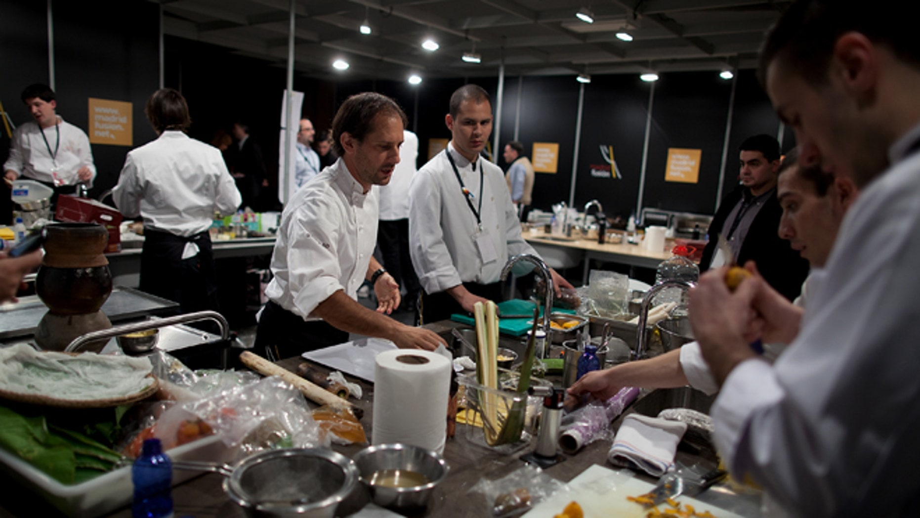 MADRID, SPAIN - JANUARY 26:  Peruvian Chef Pedro Miguel Schiaffino (3L) and his team prepares the food before a lecture on the third day of 'Madridfusion' International Gastronomic Fair in the 'Palacio de los Congresos' on January 26, 2012 in Madrid, Spain.  (Photo by Pablo Blazquez Dominguez/Getty Images)