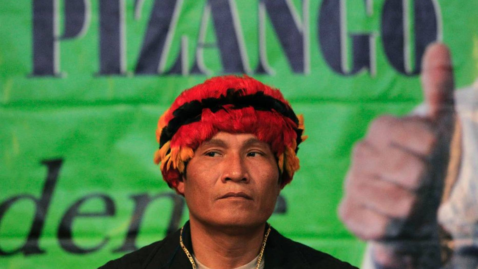 FILE - In this Nov. 18, 2010, file photo, Peru's Amazon leader Alberto Pizango looks on during an act after announcing his candidacy for Peru's 2011 presidential elections in Lima, Peru. Pizango and 52 others went on trial Wednesday in the killing of a dozen police officers after security forces fired on protesters opposed to plans to open the Amazon to widespread logging and oil drilling. (AP Photo/Martin Mejia, File)